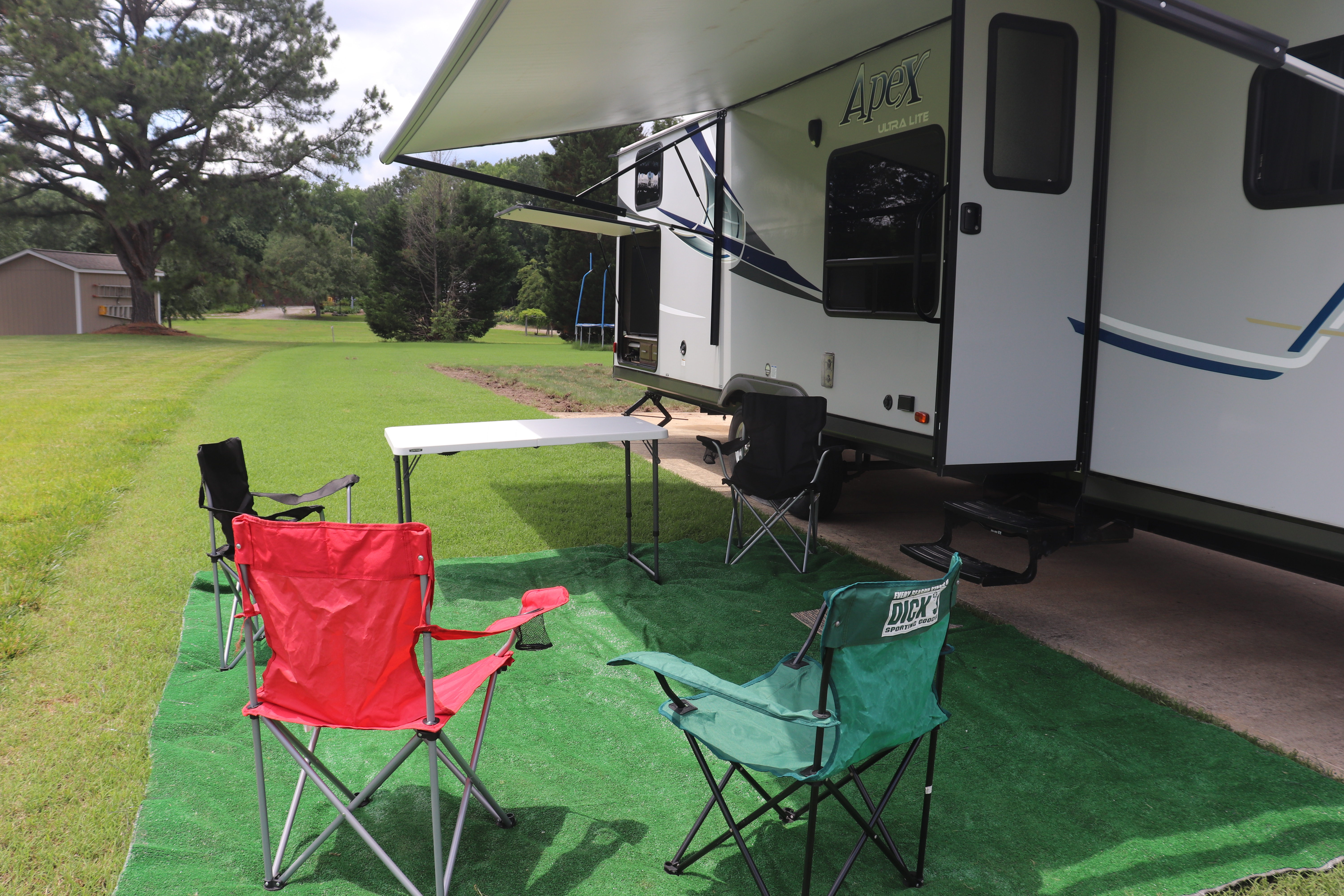 Large outdoor carpet with 4 folding chairs and 4 ft table for your convenience.. Coachmen Apex 2017
