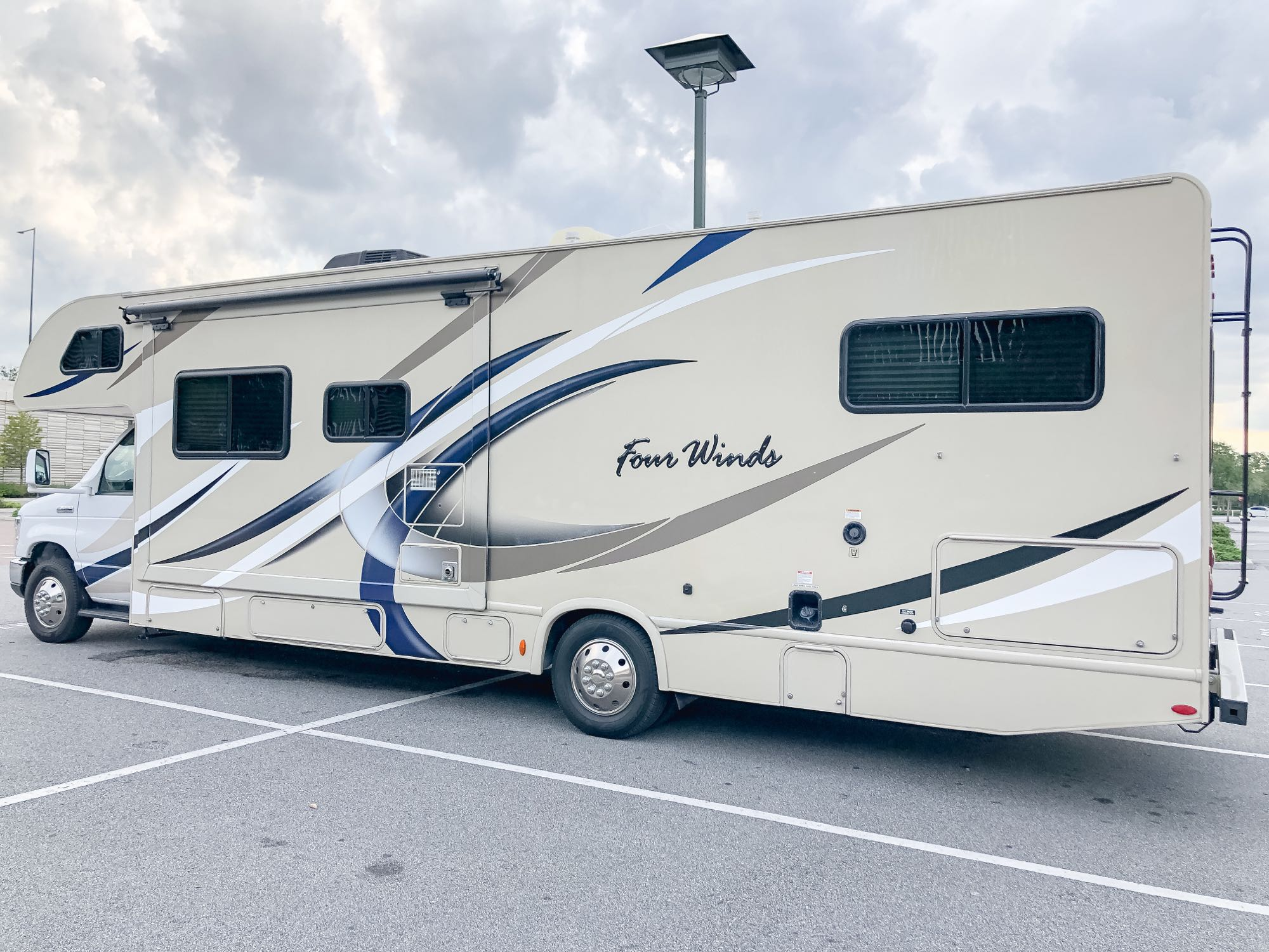 Large slide out for spacious Sofa & Dining Area. Thor Motor Coach Four Winds 2019