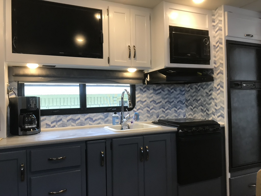 Updated kitchen with flat screen TV directly across from sofa for easy viewing. Thor Motor Coach A.C.E 2016