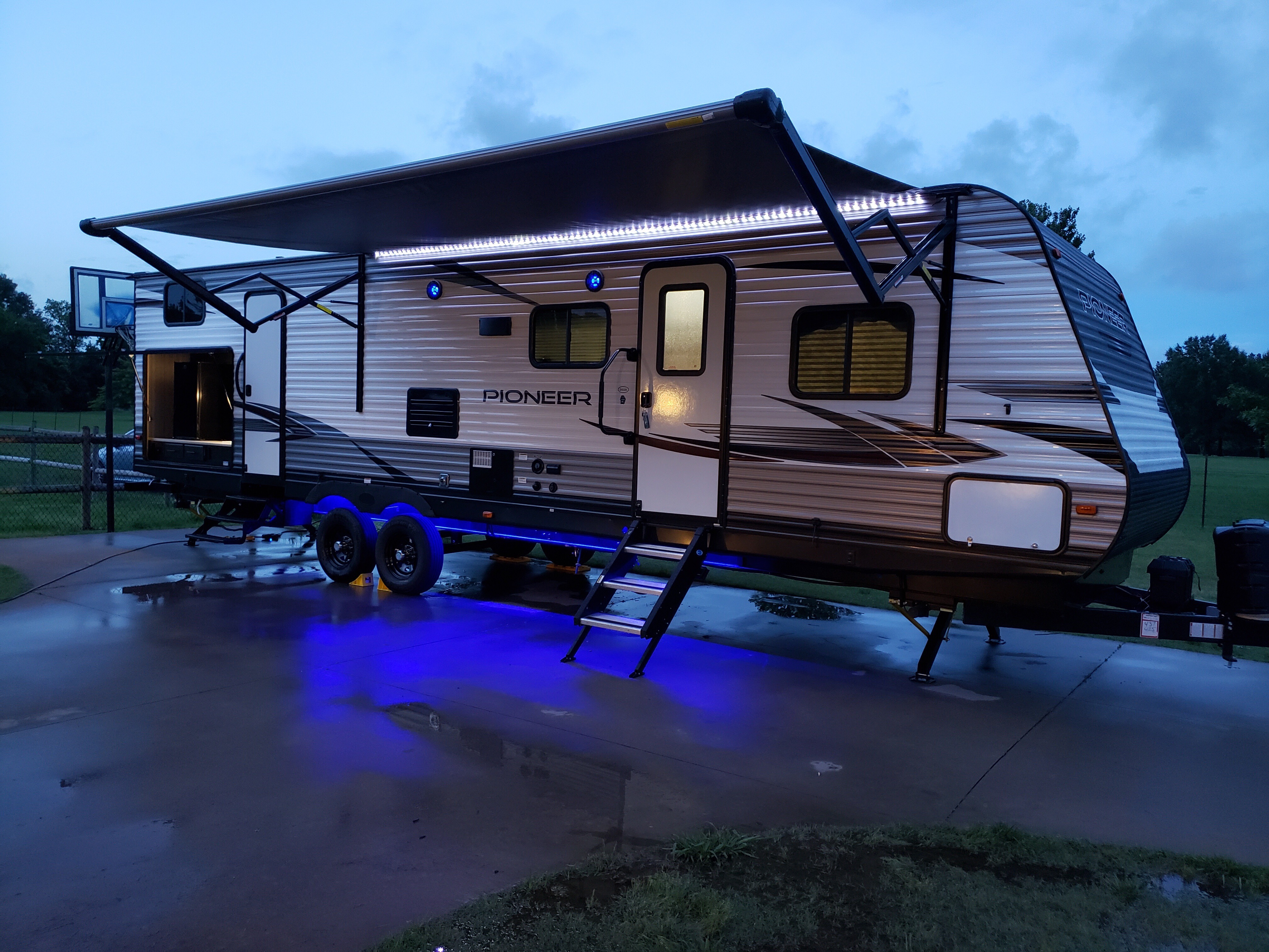Electric Awning with top and bottom LED lights. Heartland Pioneer 2020