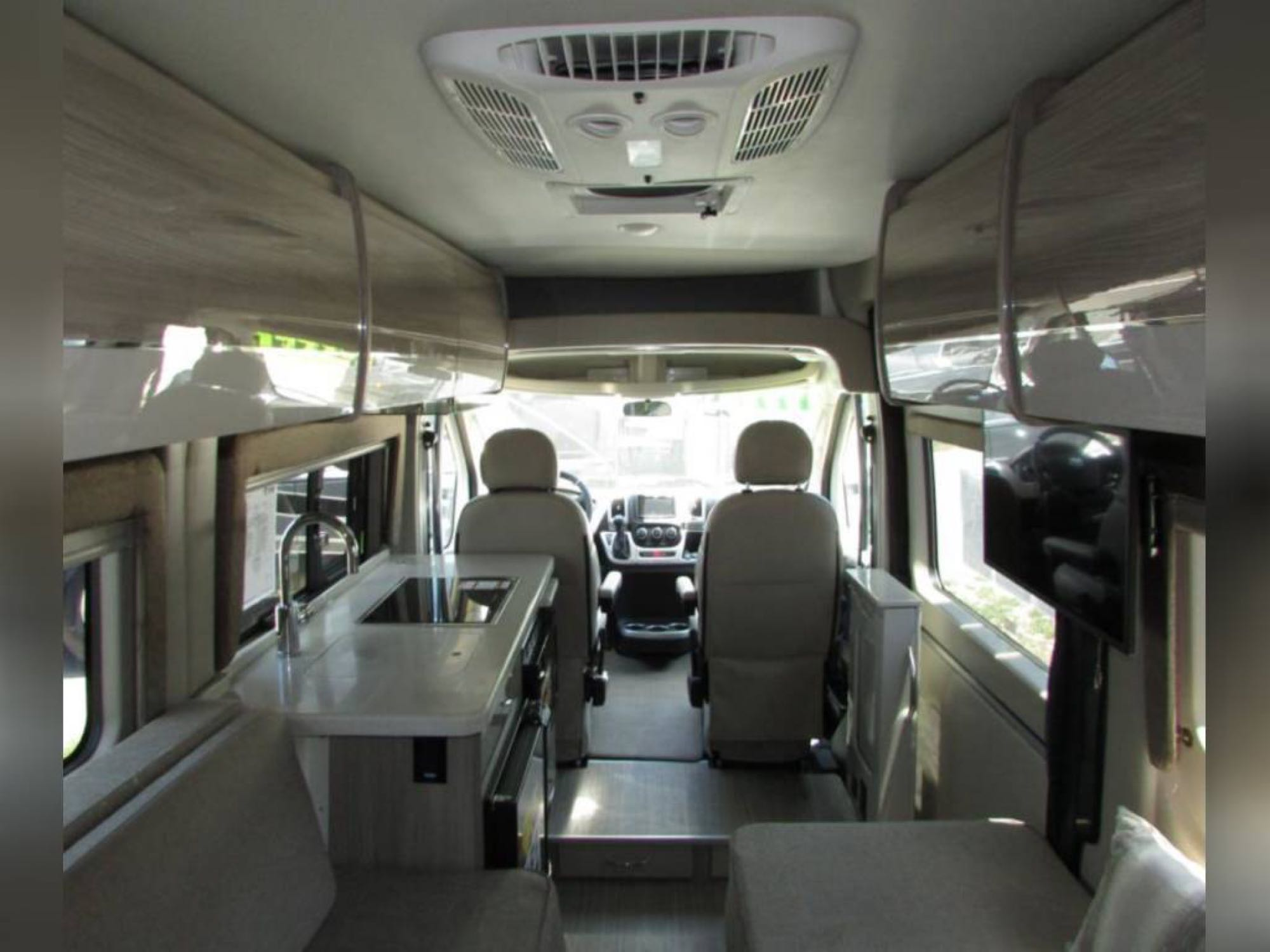 Kitchen area and drivers/passengers seats. Overhead storage.. Thor Sequence20L 2020