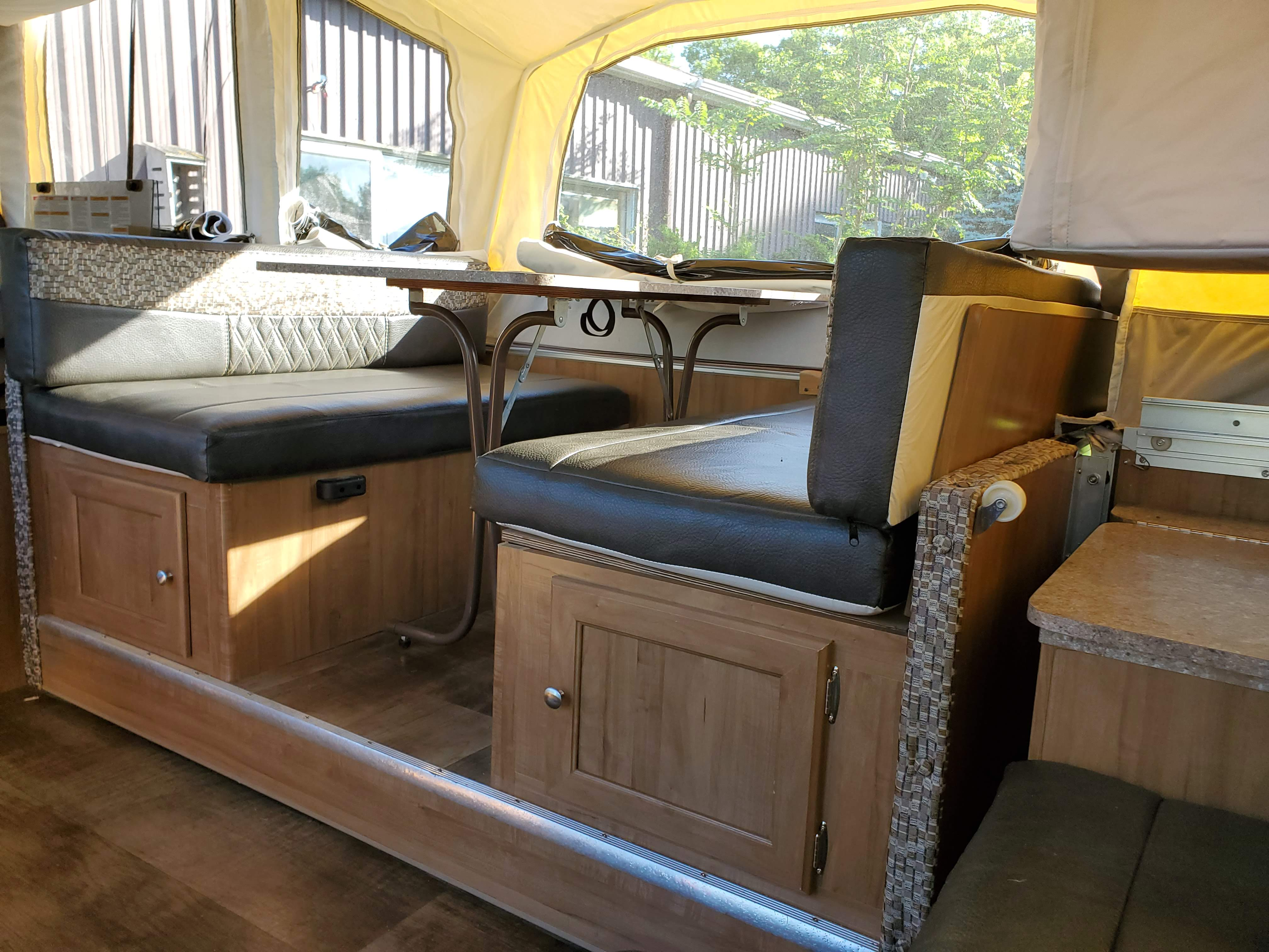 Pull out eating area adds space and can convert to a bed. Forest River Rockwood Premier 2017