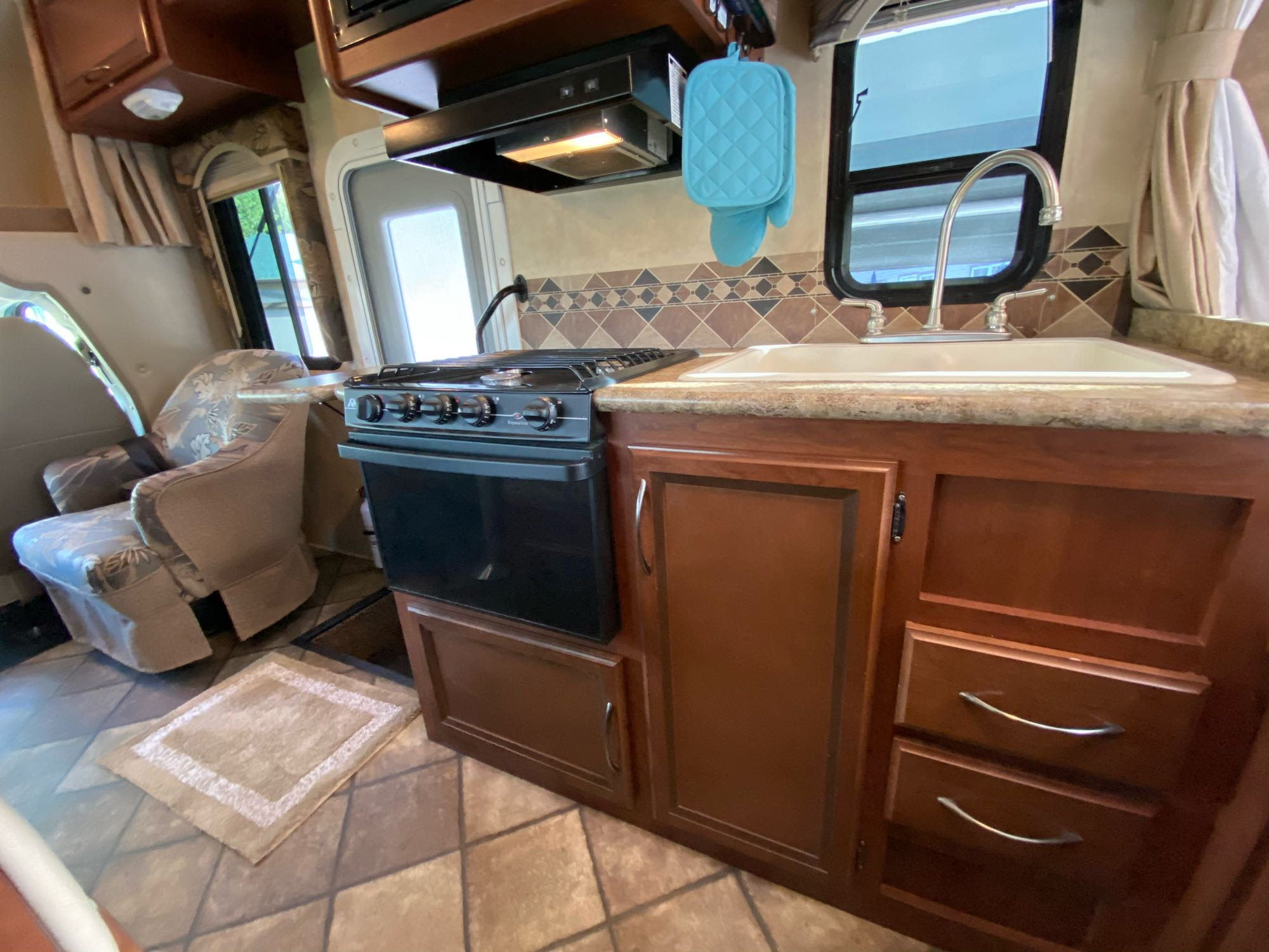 Kitchen includes cooking utensils,plates, pots and pans.. Thor Motor Coach Freedom Elite 2014