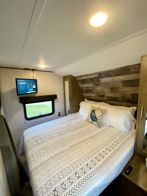 "24"" Smart TV Mounted over Queen Bed. Dutchmen Aspen Trail 2020"