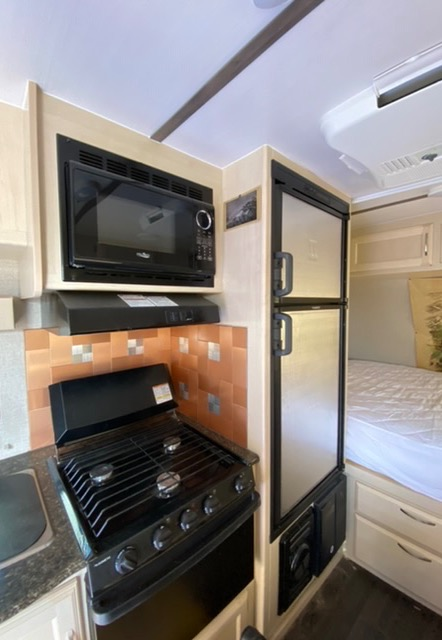 3 burner stover and oven and microwave and bigger fridge with separate freezer. Winnebago Micro Minnie 2018