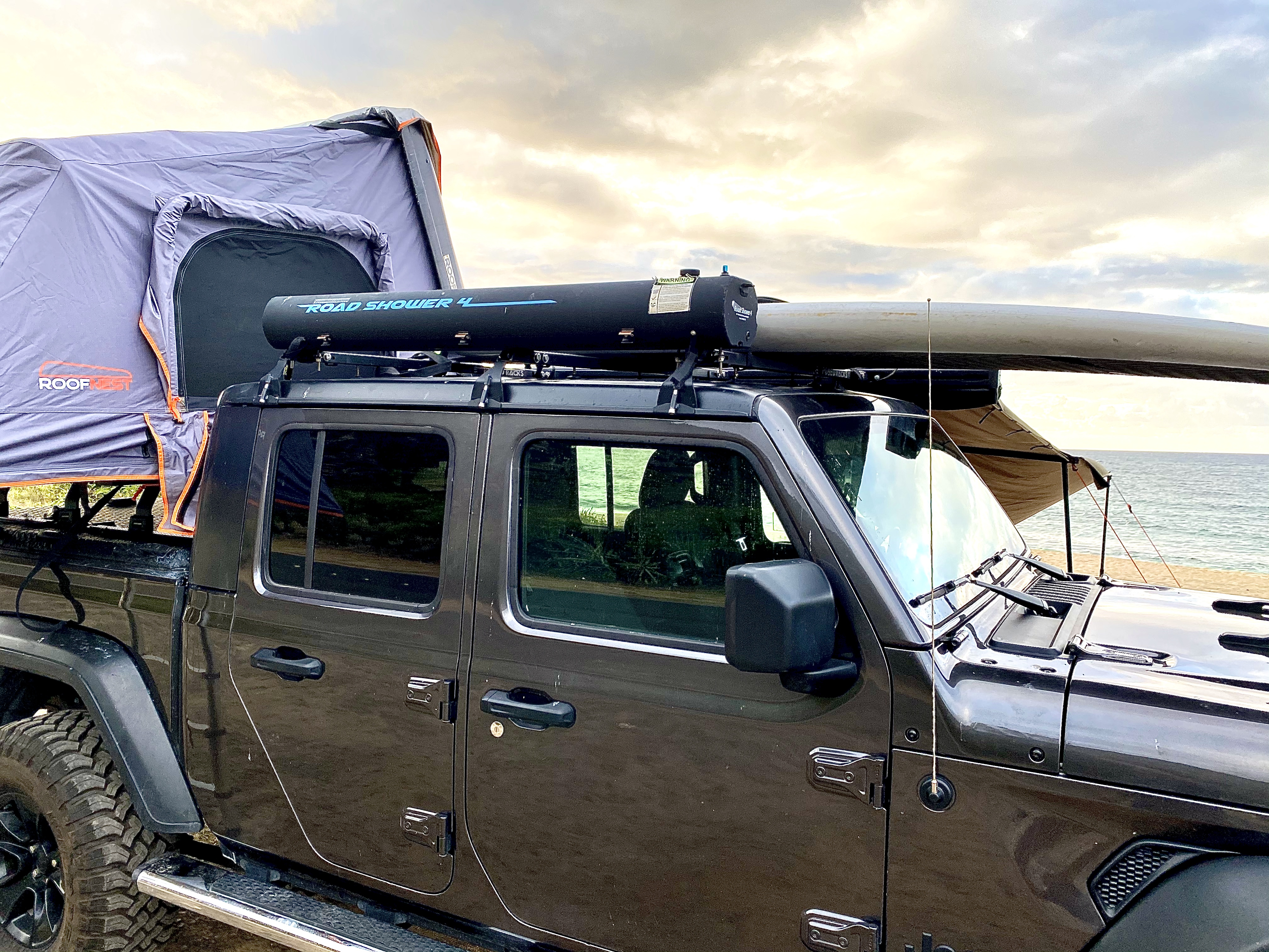 Yakima Road shower with 4 gallon water tank Along with roof rack and straps for your surfboard. Jeep Gladiator 2020