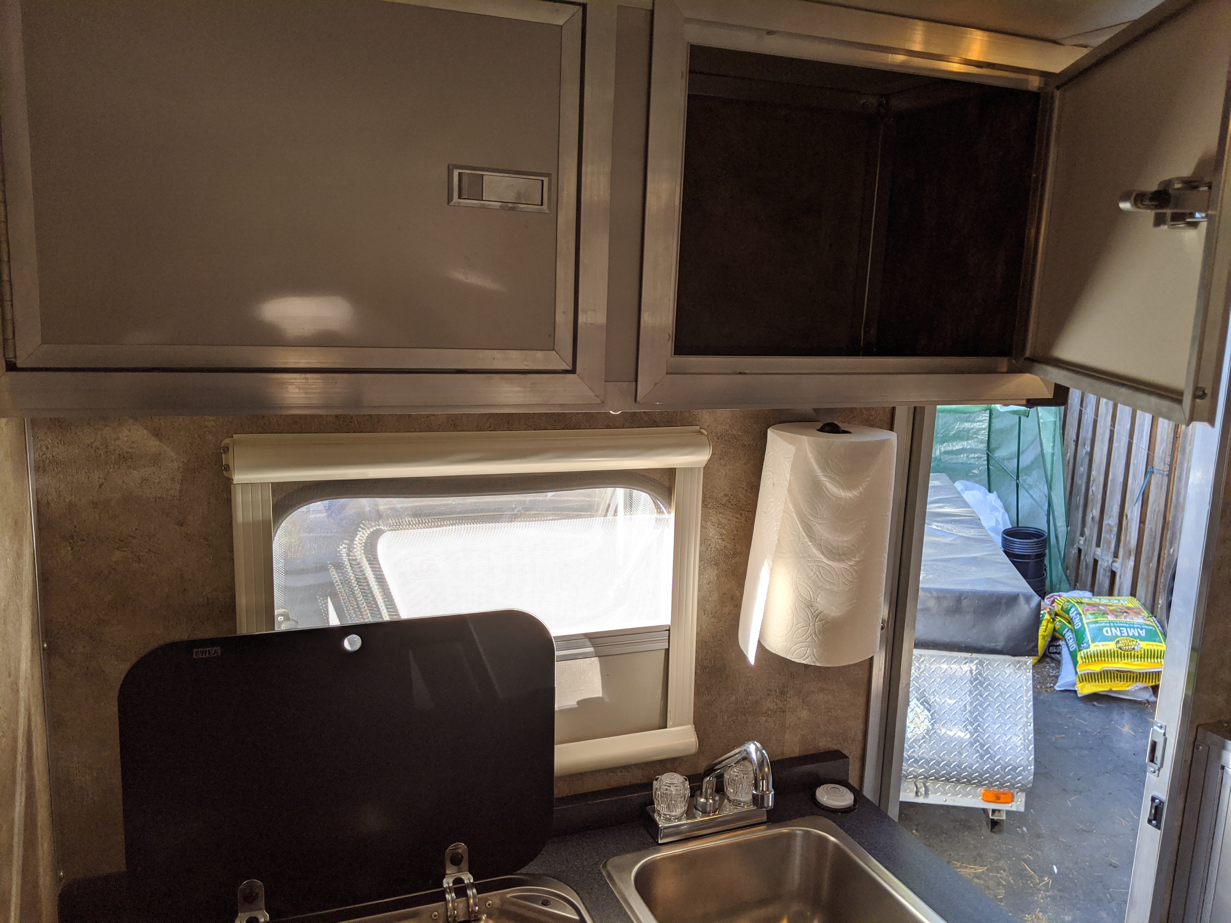 Stove and sink with storage above. Livin' Lite Camplite 2012