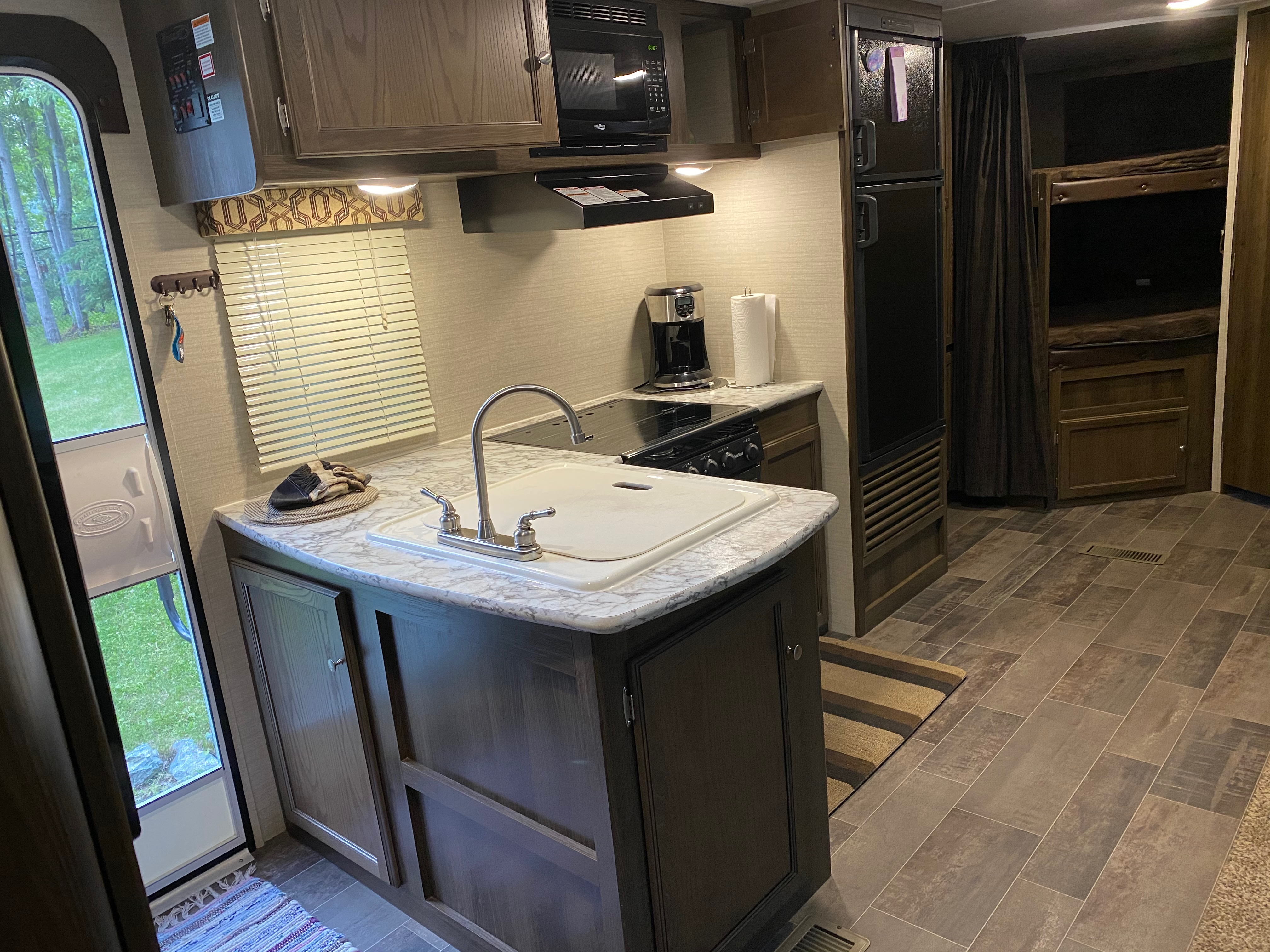 Entry door and kitchen.. Keystone Ultra lite Bullet 2017
