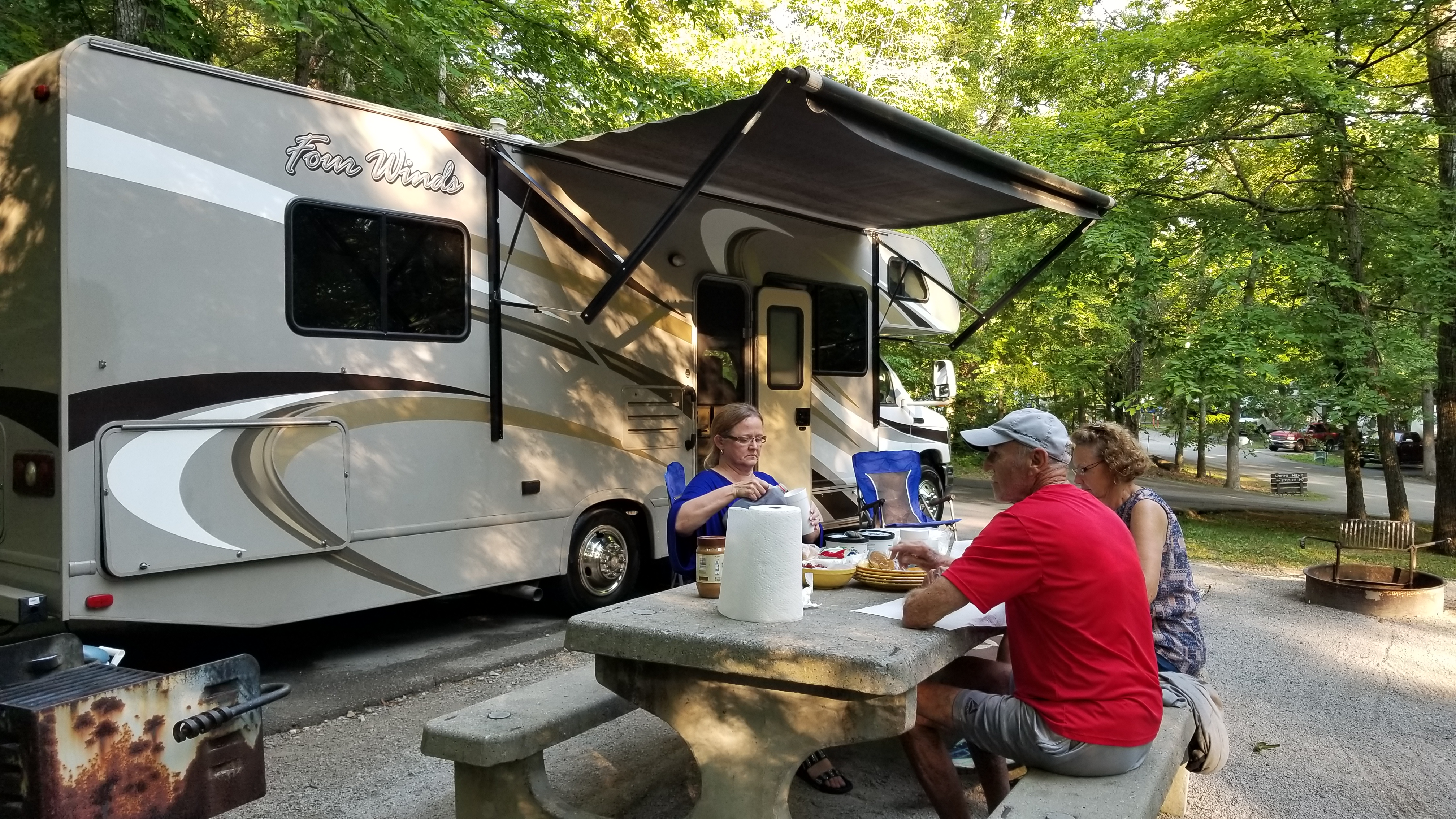 Some campgrounds provide picnic tables. If not, we keep one in the rigs basement.. Thor Motor Coach Four Winds 2016