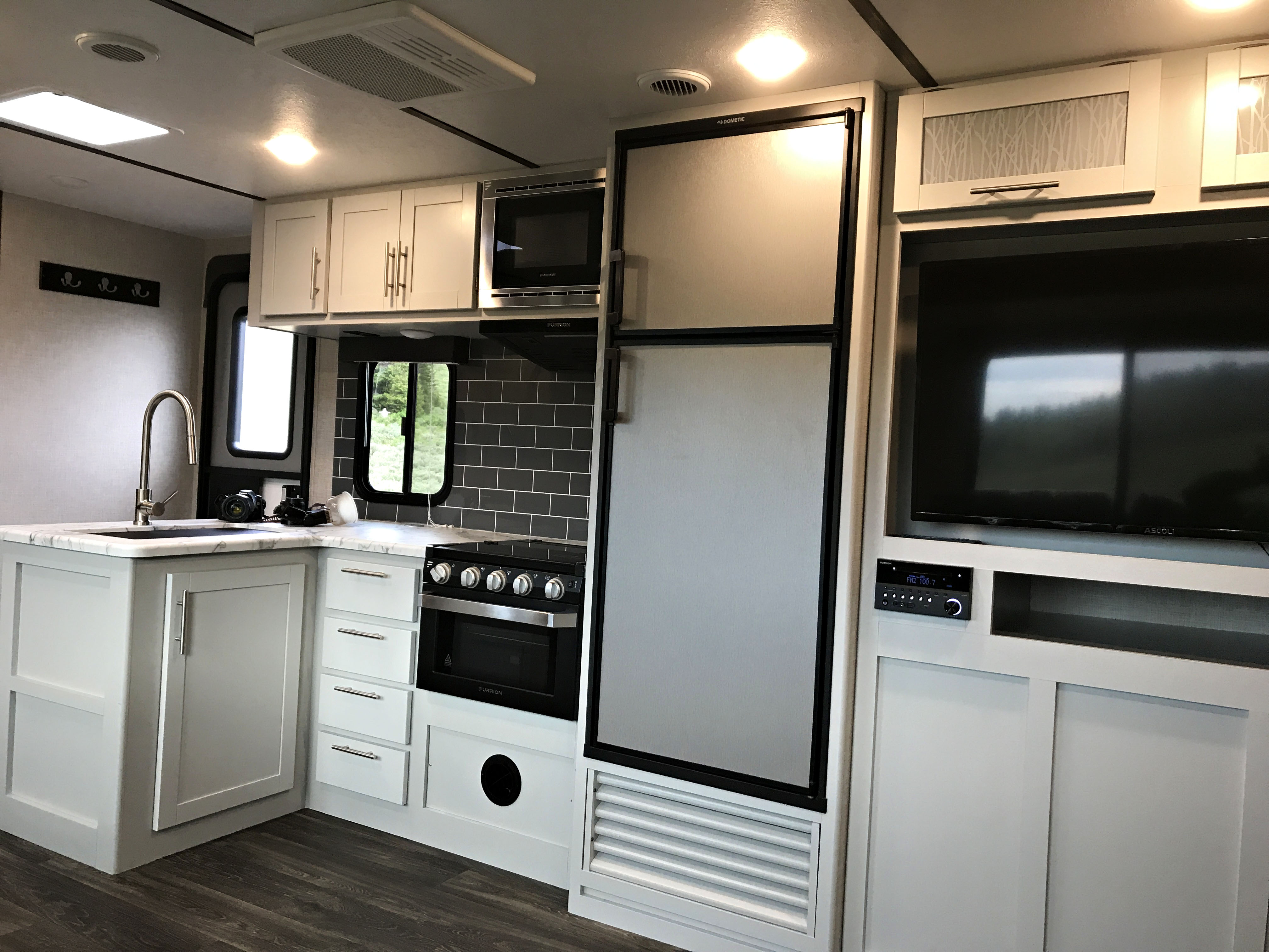 Fridge/freezer, stove/oven combo with large stainless steel sink.. Keystone Bullet Bunkhouse 2021