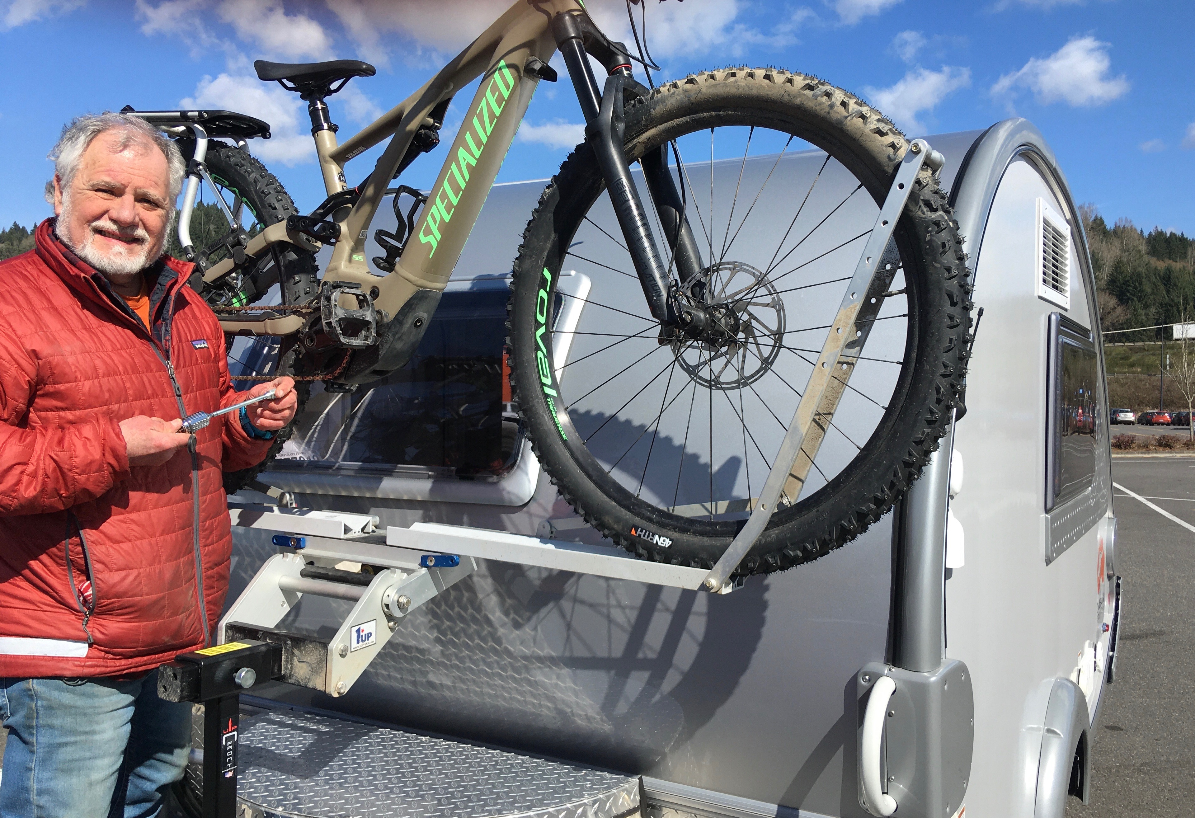 Have bike rack that mounts on the tongue of the trailer.. T@B Little Guy 2017