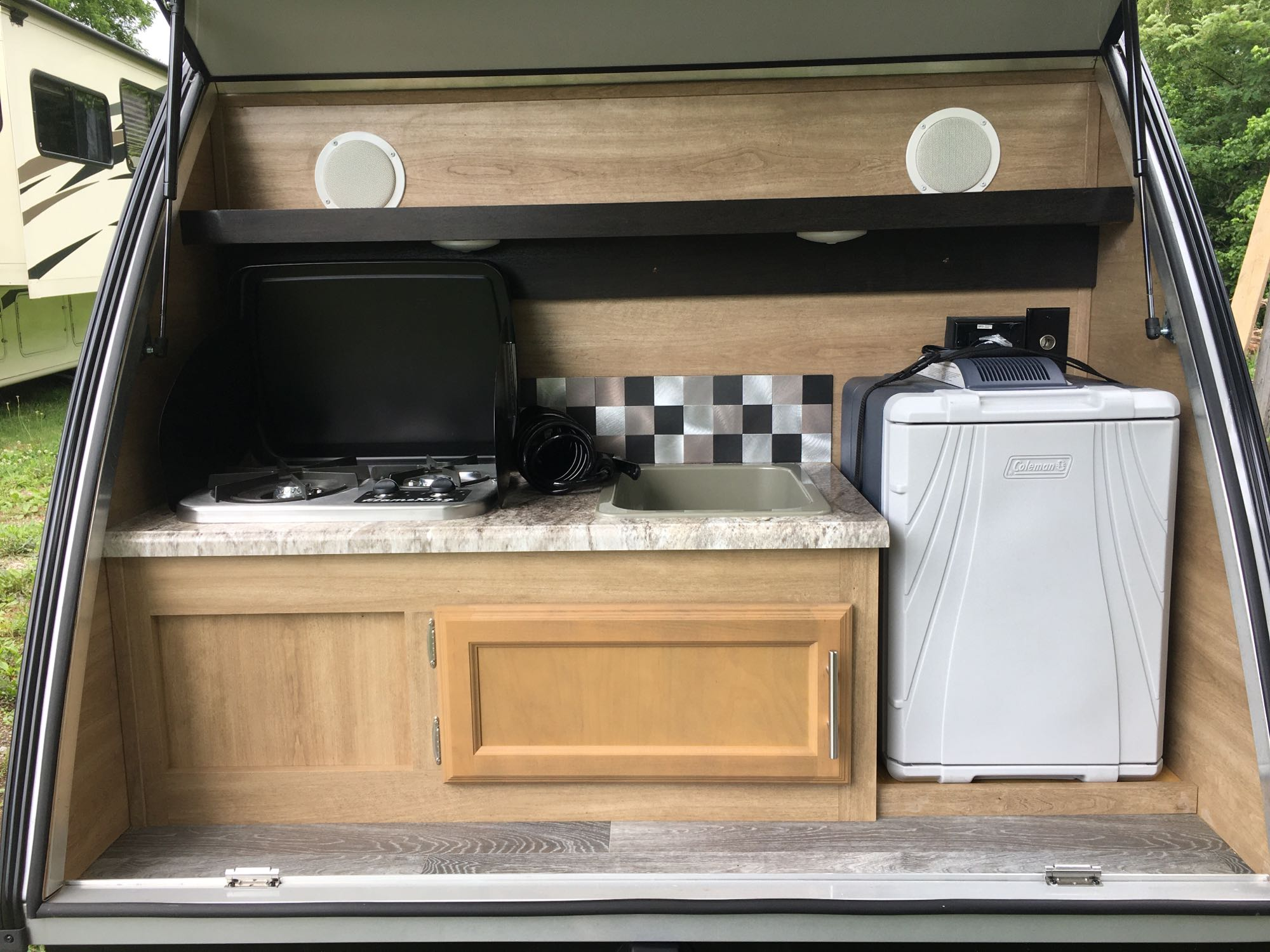 Cook top, sink, and refrigerator. Braxton Creek Bushwhacker 2020