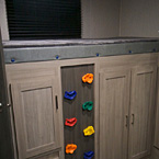 Rock climbing wall to a full sized bunk.. Coachmen Freedom Express 2020