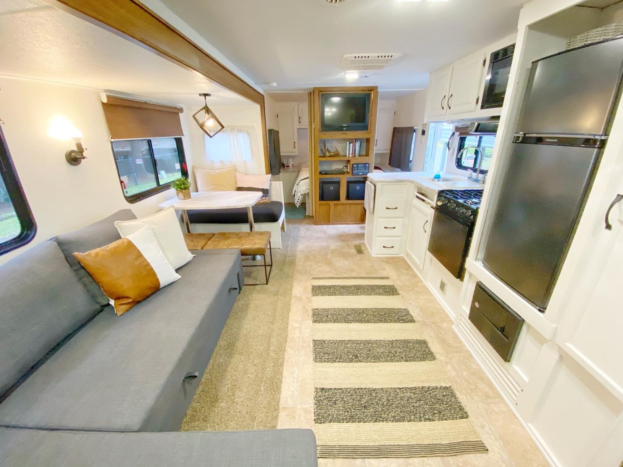 """View from back by bathroom and bunkspaces. Behind entertainment center is """"master suite"""". Outdoors Rv Manufacturing Creek Side 2012"""