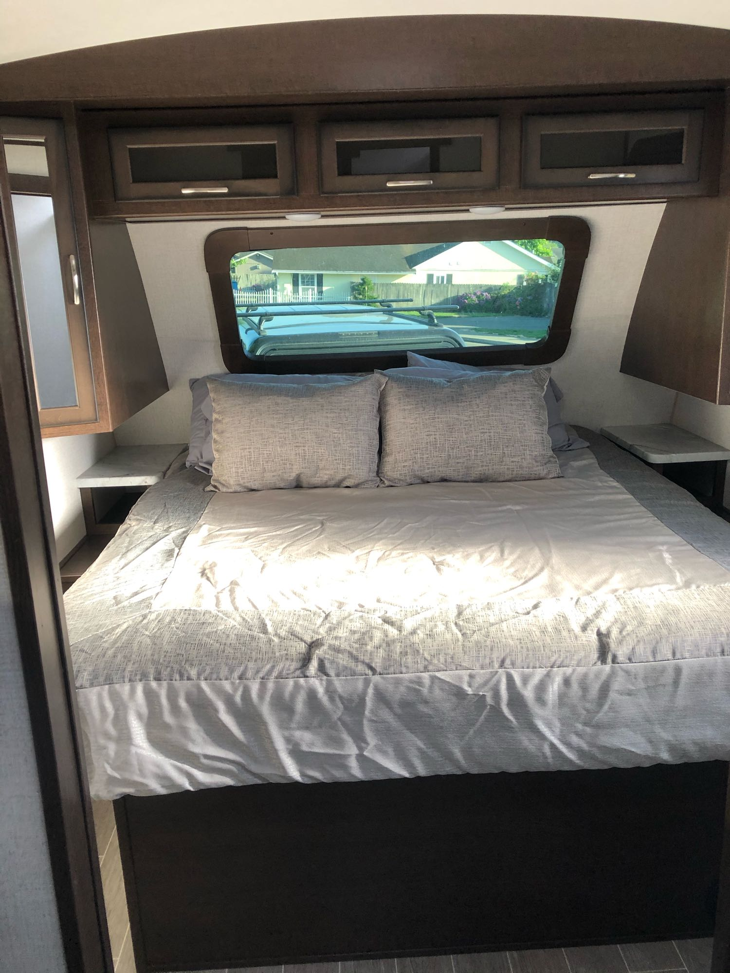 The master king-sized bed in the front of the trailer.. Dutchmen Other 2020