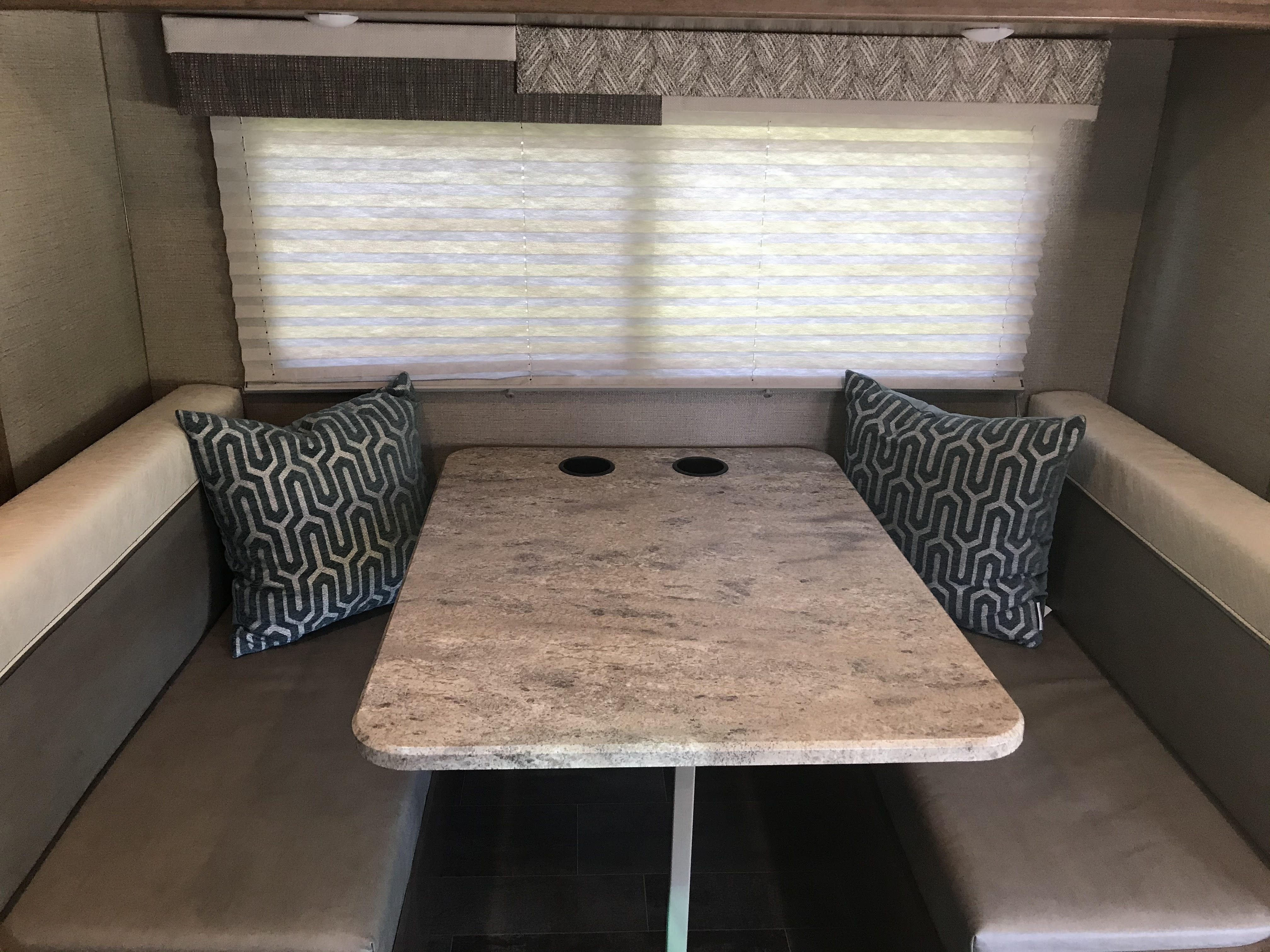 Table & Chairs (slideout), with 4 seatbelts. Winnebago Outlook 2019