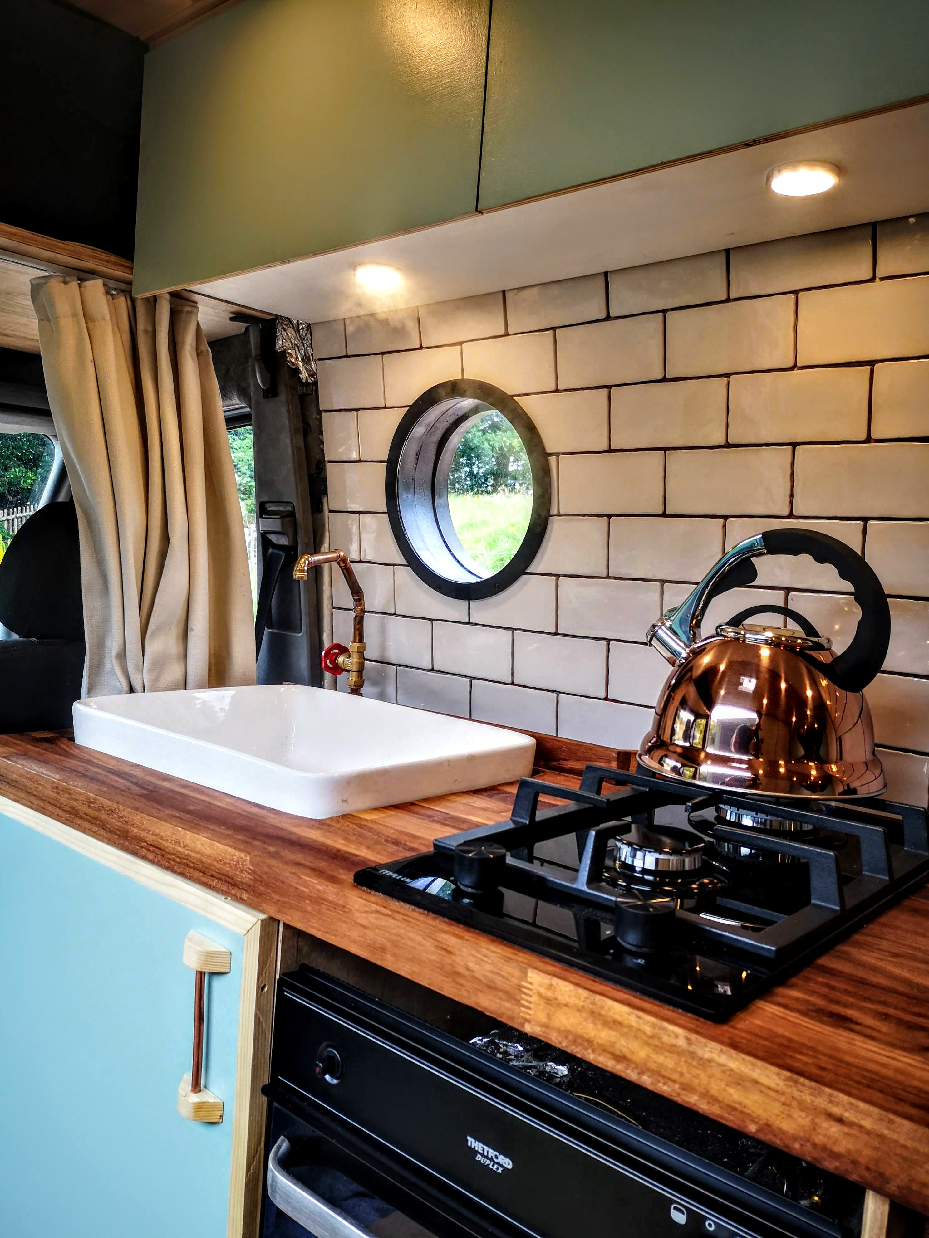 Large kitchen with Porcelain sink, 2 burner stove, full Oven, Fridge Freezer, Running water, and even a gorgeous view from the sidewindow. Mercedes-Benz 313 Sprinter LWB Motorhome 2014
