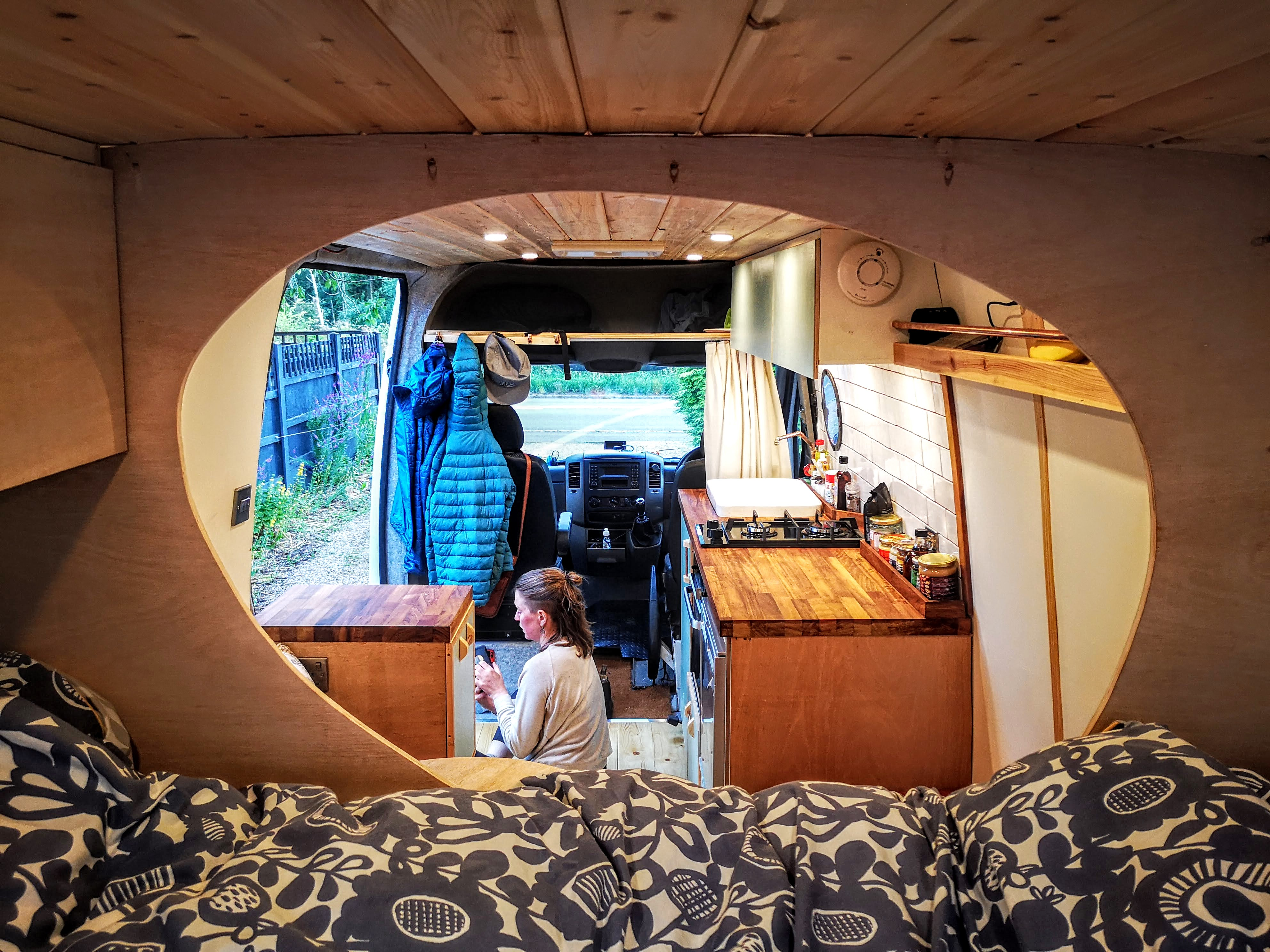 View from the bedroom into the living area through the 'mini egg' wall!. Mercedes-Benz 313 Sprinter LWB Motorhome 2014