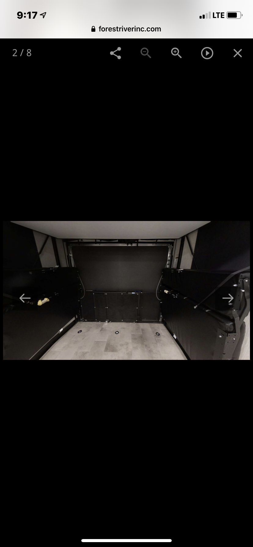 View of couches and queen bed lifted for hauling purposes. Forest River Raptor 2020