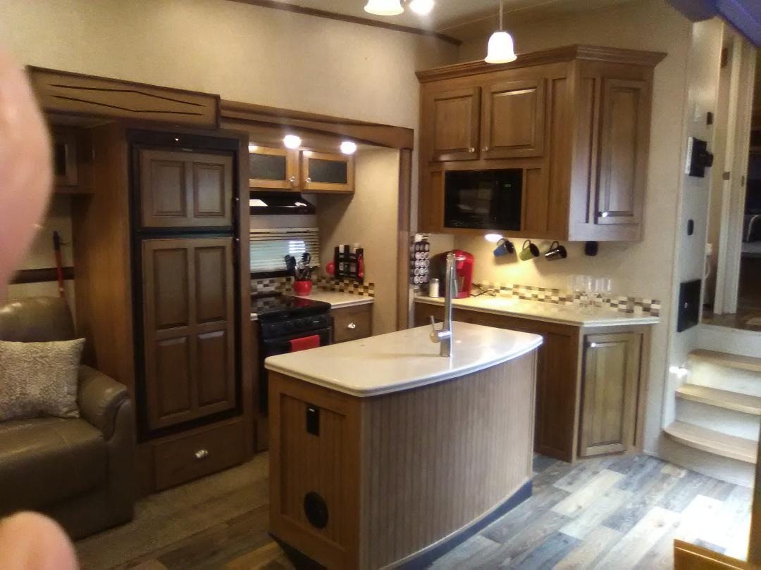 Beautiful kitchen with center island, coffee station, 3 burner stove, good size refrig/freezer,  dishes, pots/pans.  . Forest River Rockwood Signature Ultra 2017