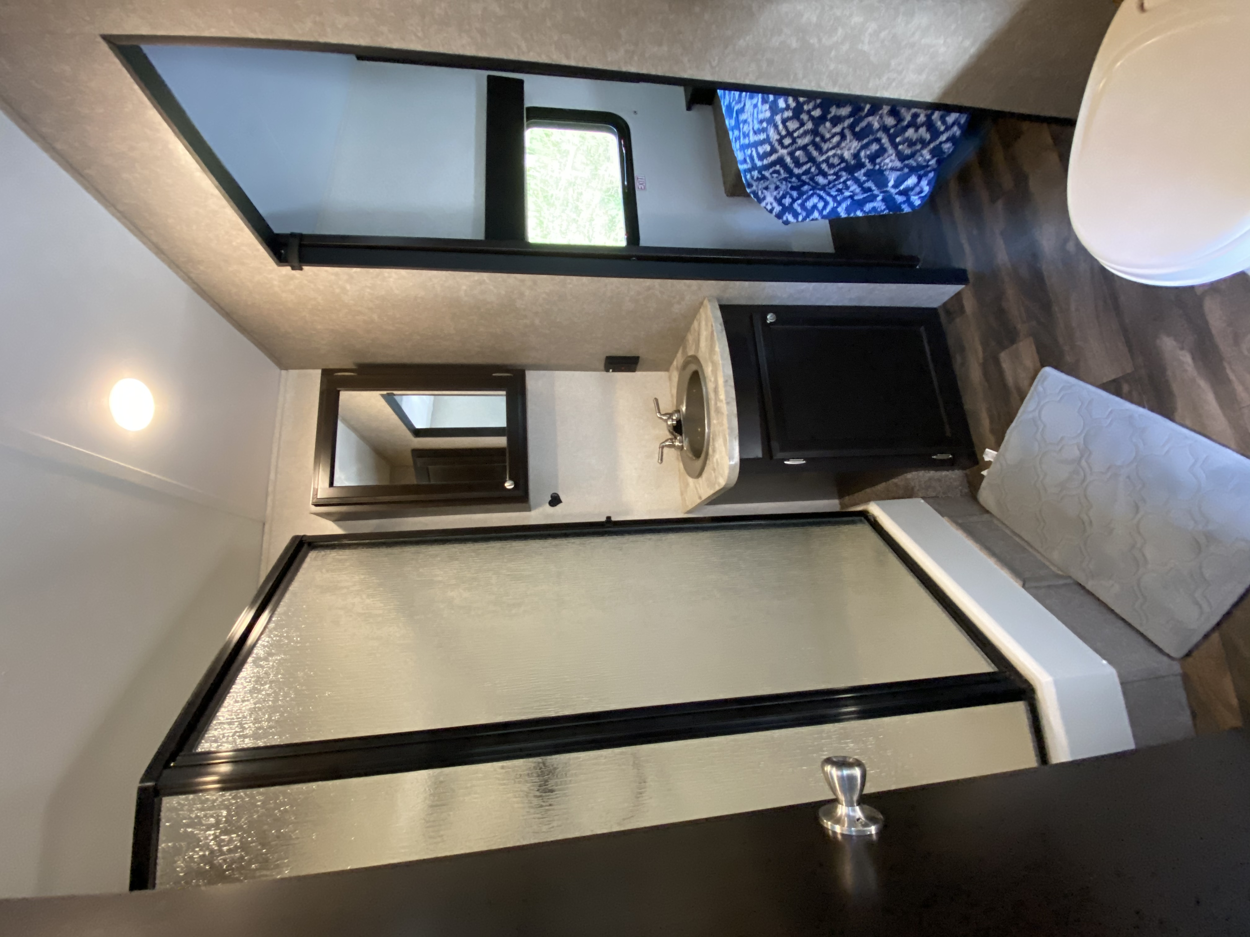 Large bathroom with shower and storage.. Jayco Octane 2017