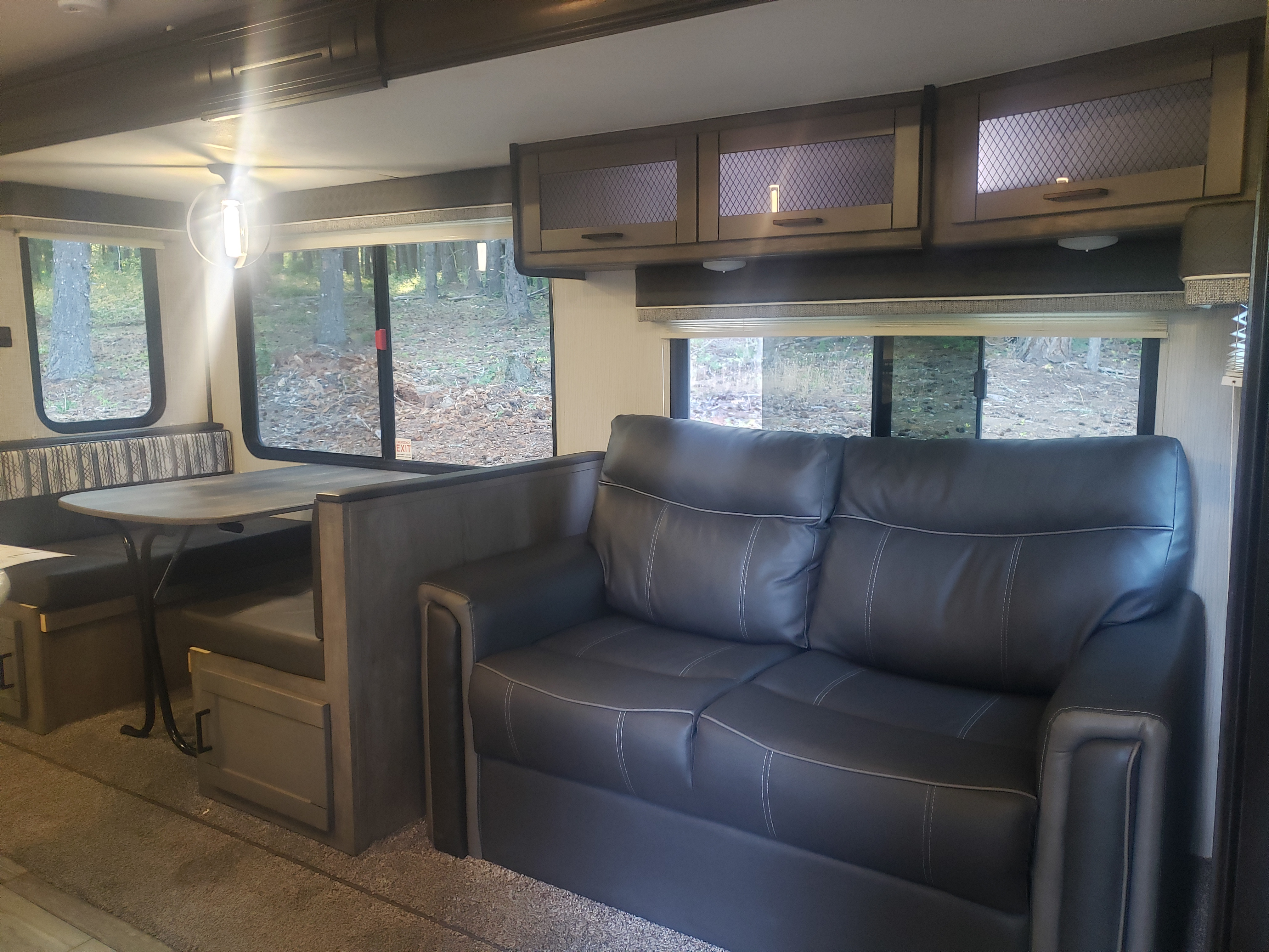 Dinette and couch convert to sleeping areas. Heartland North Trail 2020