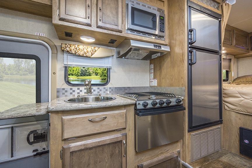 Kitchen with stainless steel appliances!. Gulf Stream Conquest 2016