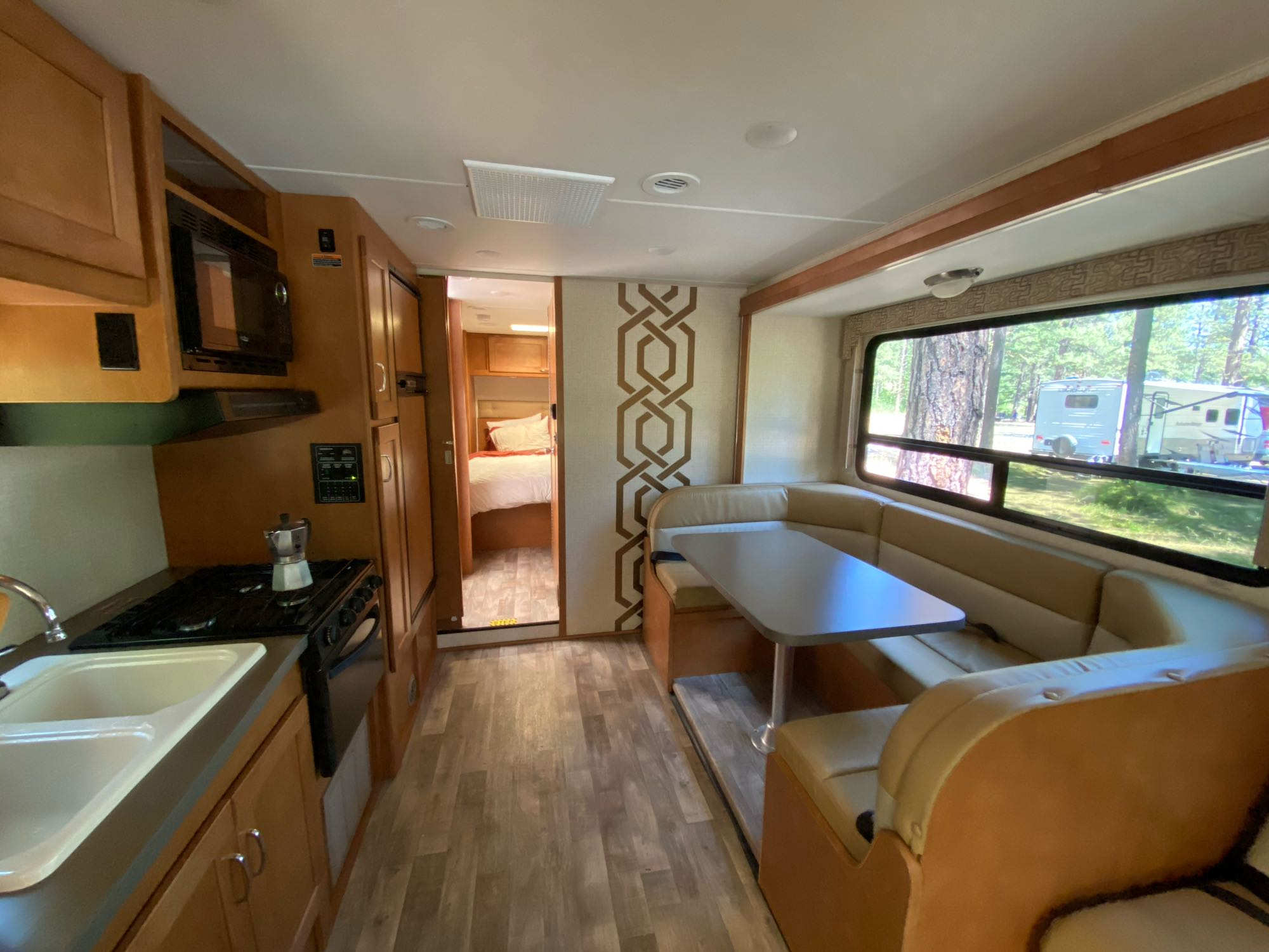 The u-shaped dinette is great for gatherings. It also converts into a bed. This view is with the slide-out open.. Winnebago MinnieWinnie 2017