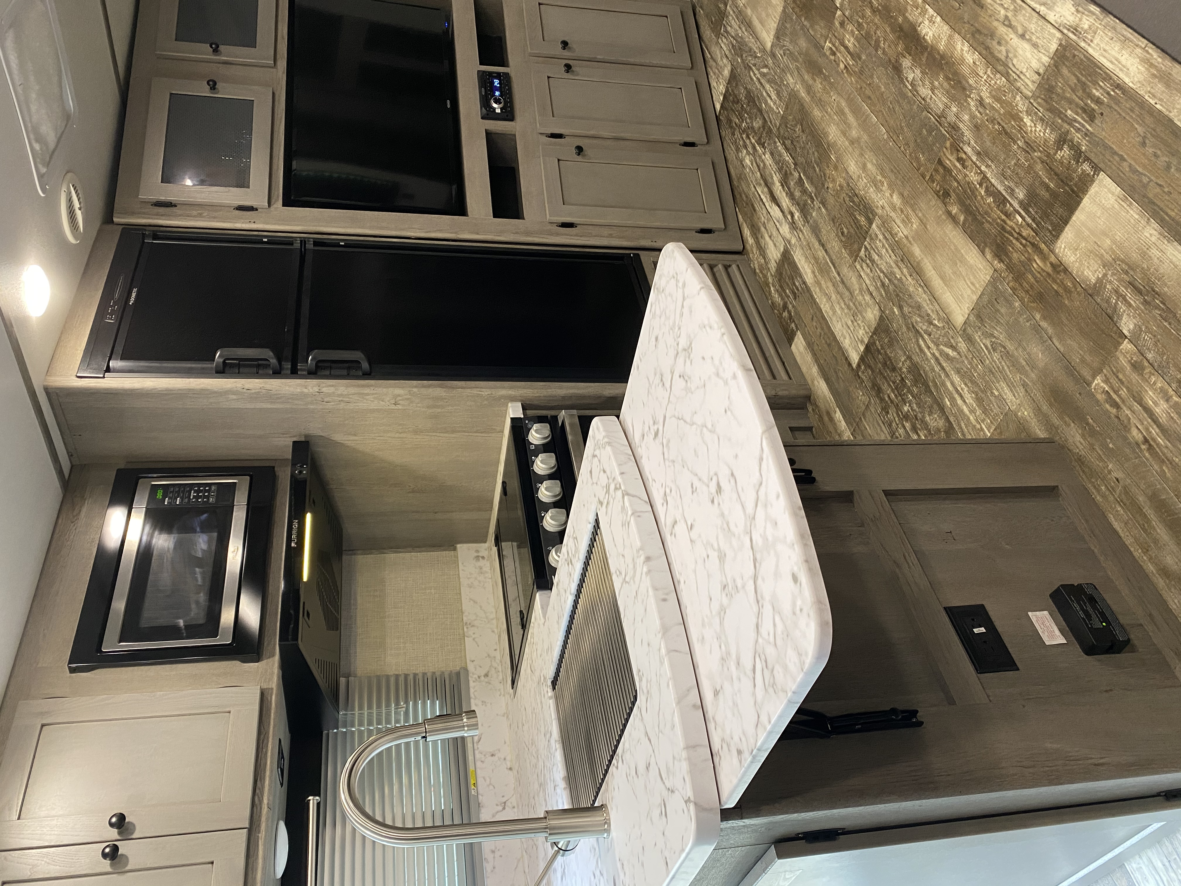 Counter extends to provide more prep space.. Keystone Outback 2020