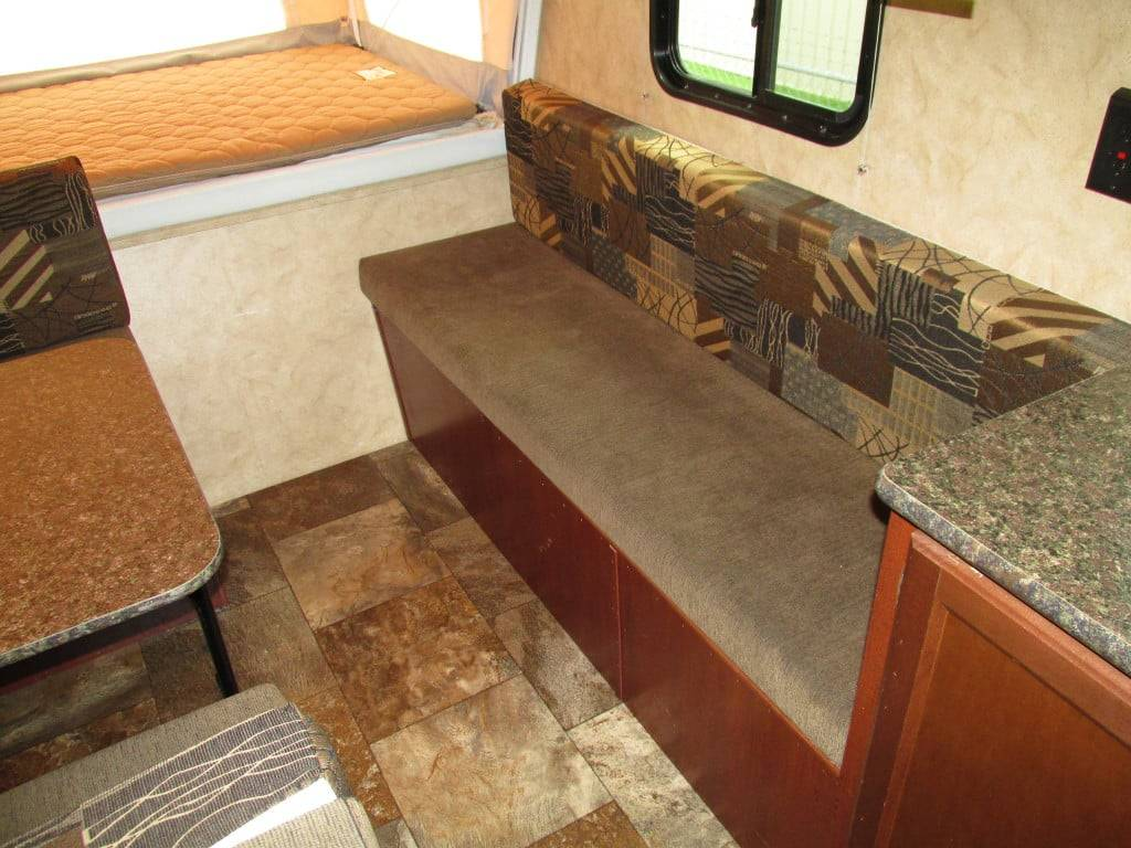Additional bench seating with storage bin underneath, which is accessible outside.. Forest River Viking 2015