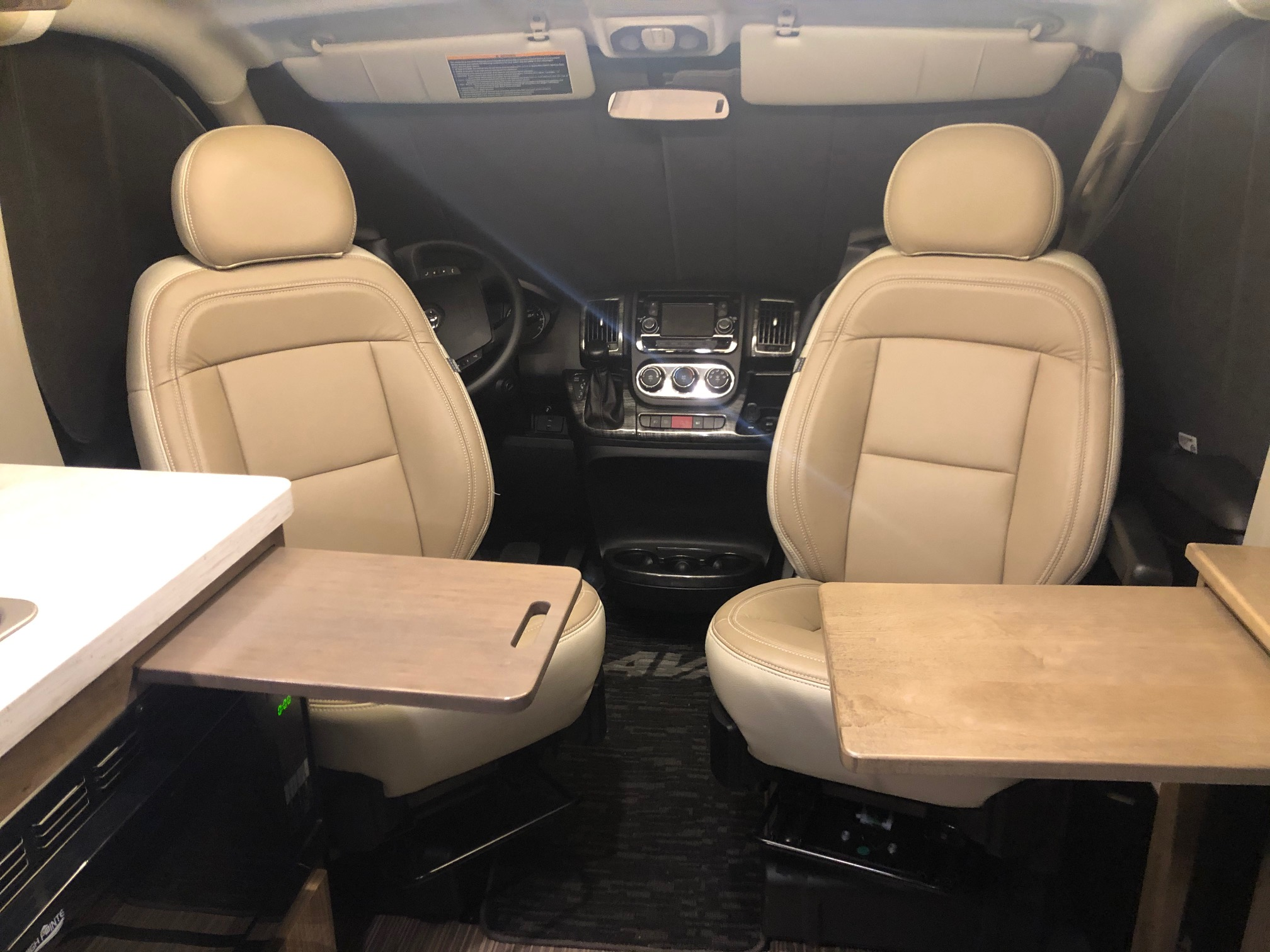 Cab chairs swivel for Eating, Watching TV/A Movie, Working, Etc. when parked.. Winnebago Travato 2019