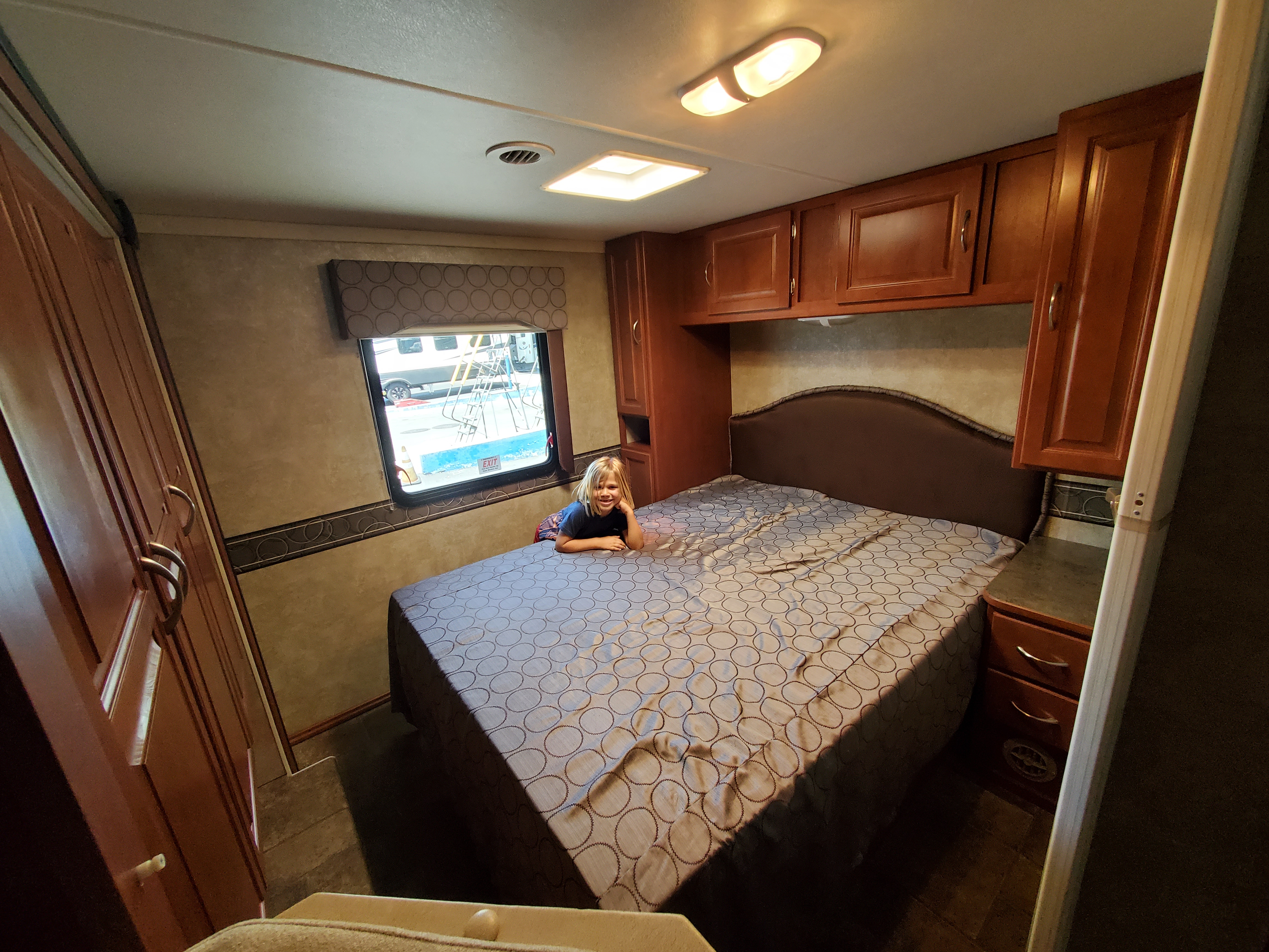 Private bedroom with queen size bed, lots of hanging closet space and drawers.. Winnebago Minnie Winnie 2014