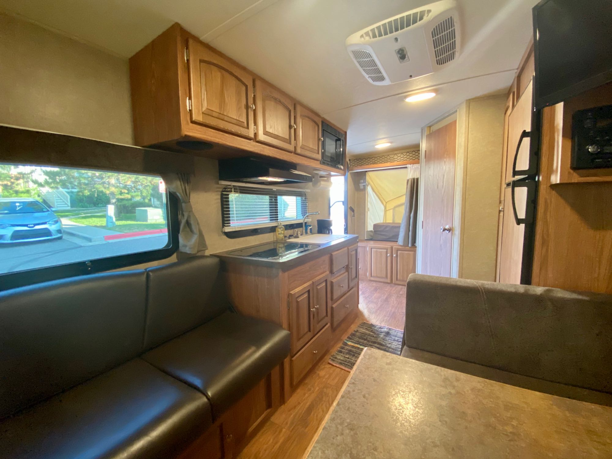 couch and kitchen from dinette at back. Forest River Rockwood Roo 2015