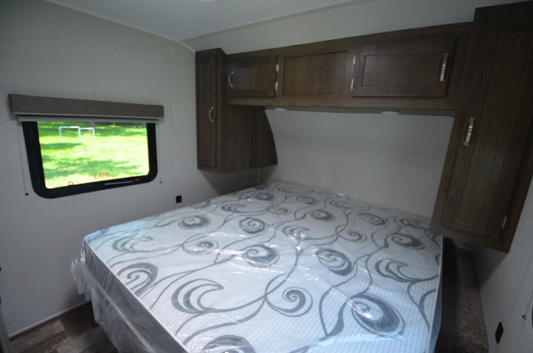King size bed in this private bedroom with two windows and tons of storage space. East to West Silver Lake 27 KNS 2021