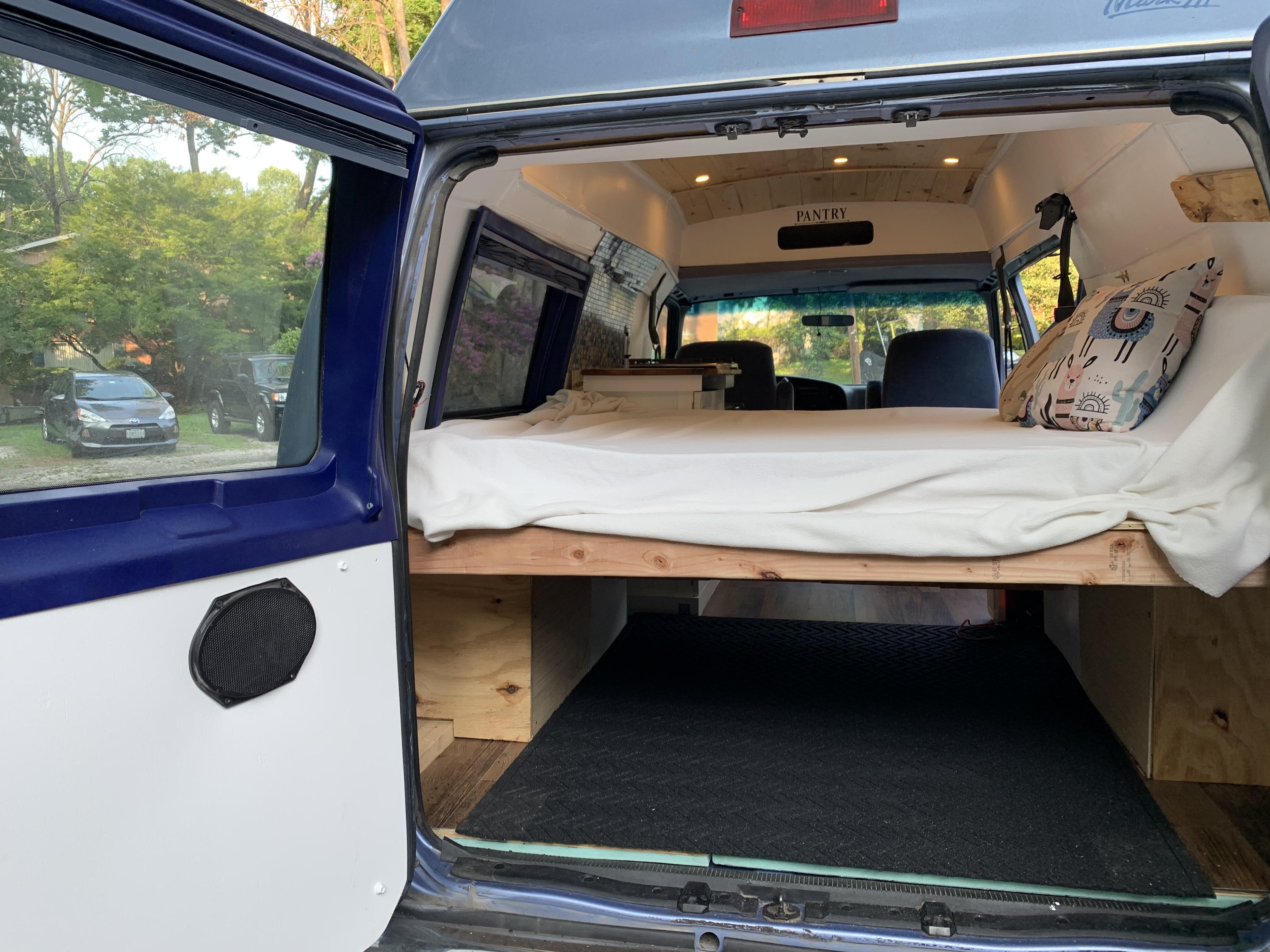 Back of van shows storage under bed for gear.. Ford Econoline 1995