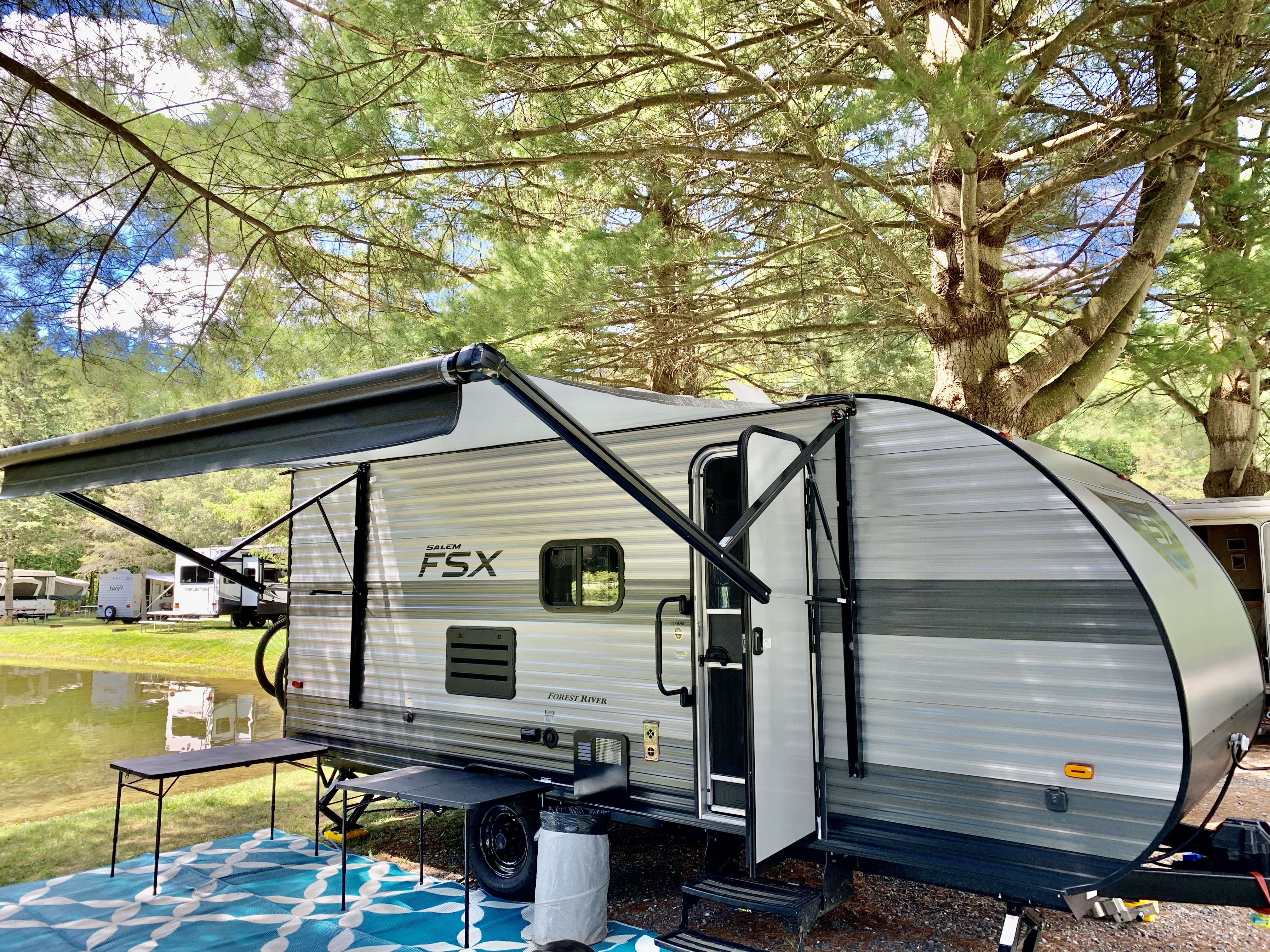 Exterior with 12' electric awning. Forest River Salem 2020
