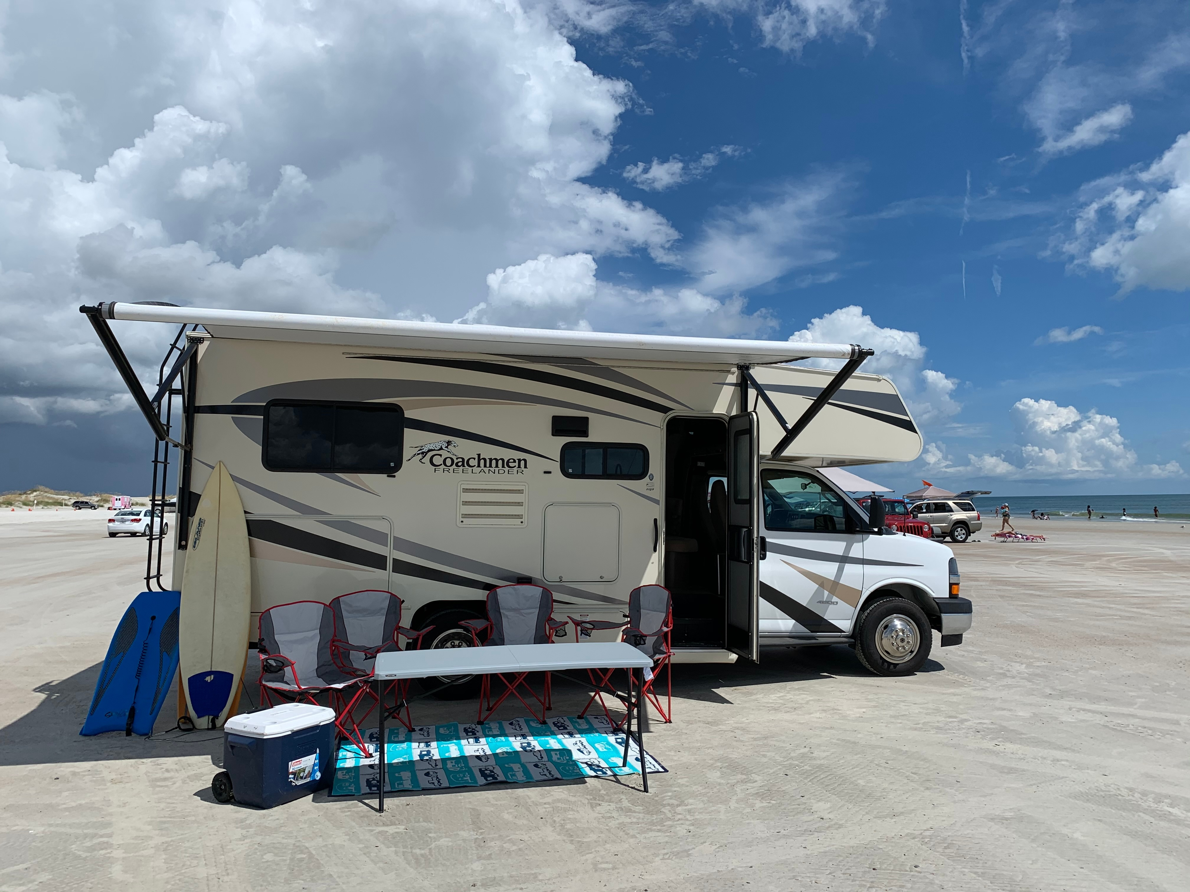not shown in pic are two larger rocking camping chairs, larger 9'x18' reversible outdoor rug.. Coachmen Freelander 21QB 2018