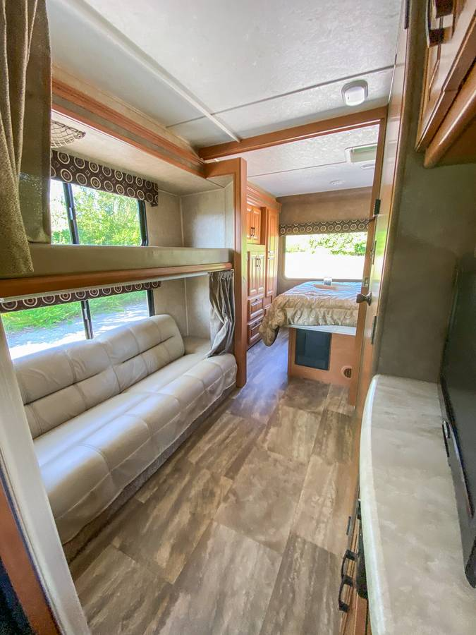Bunk area.  Couch jack-knifes into bed, TV across bunk area for games and/or movies.. Forest River Sunseeker 2017