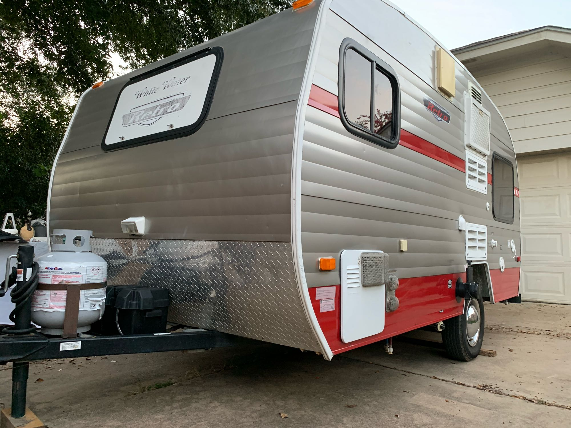 NOT your grampa's canned ham—this tiny 13 ft. long camper LOOKS retro—but inside, it's outfitted with top-of-the-line amenities and comfort.. RiversideRv Whitewater#155(DealervideosareavailableonYouTubeforthismodel) 2014