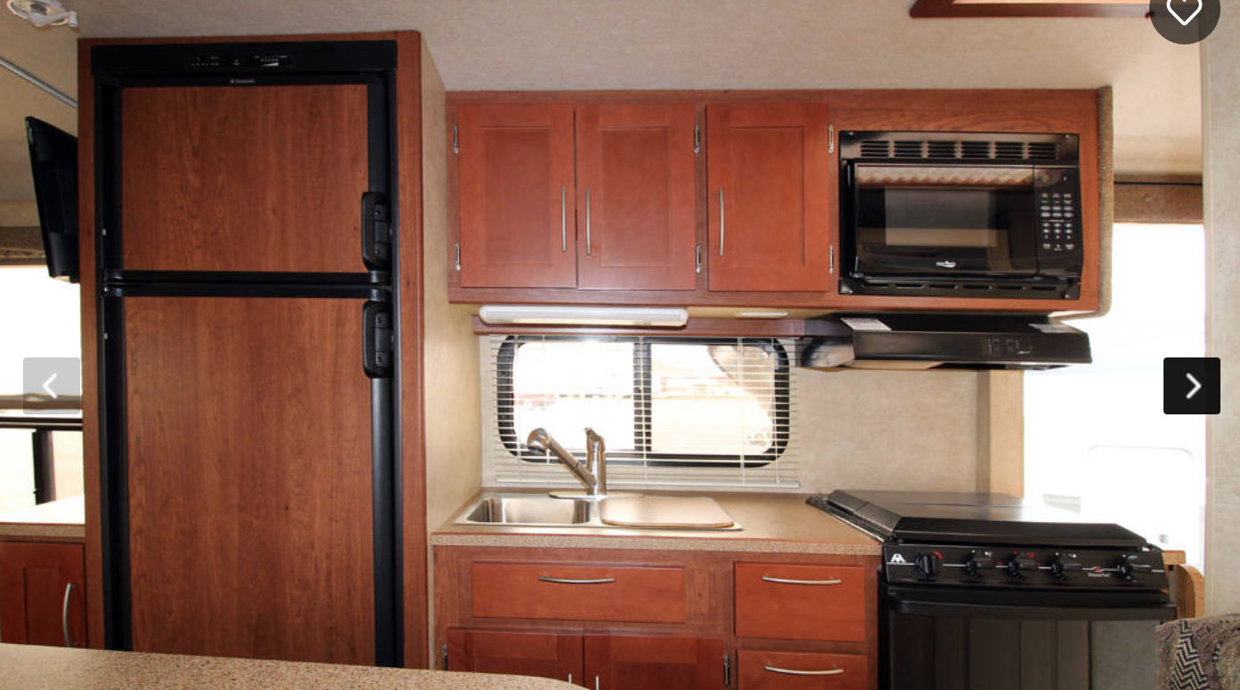 Large fridge, Freezer, Sink, Microwave, Stove and Oven. Lots of Light and Air.. Bigfoot 25b21fb 2005