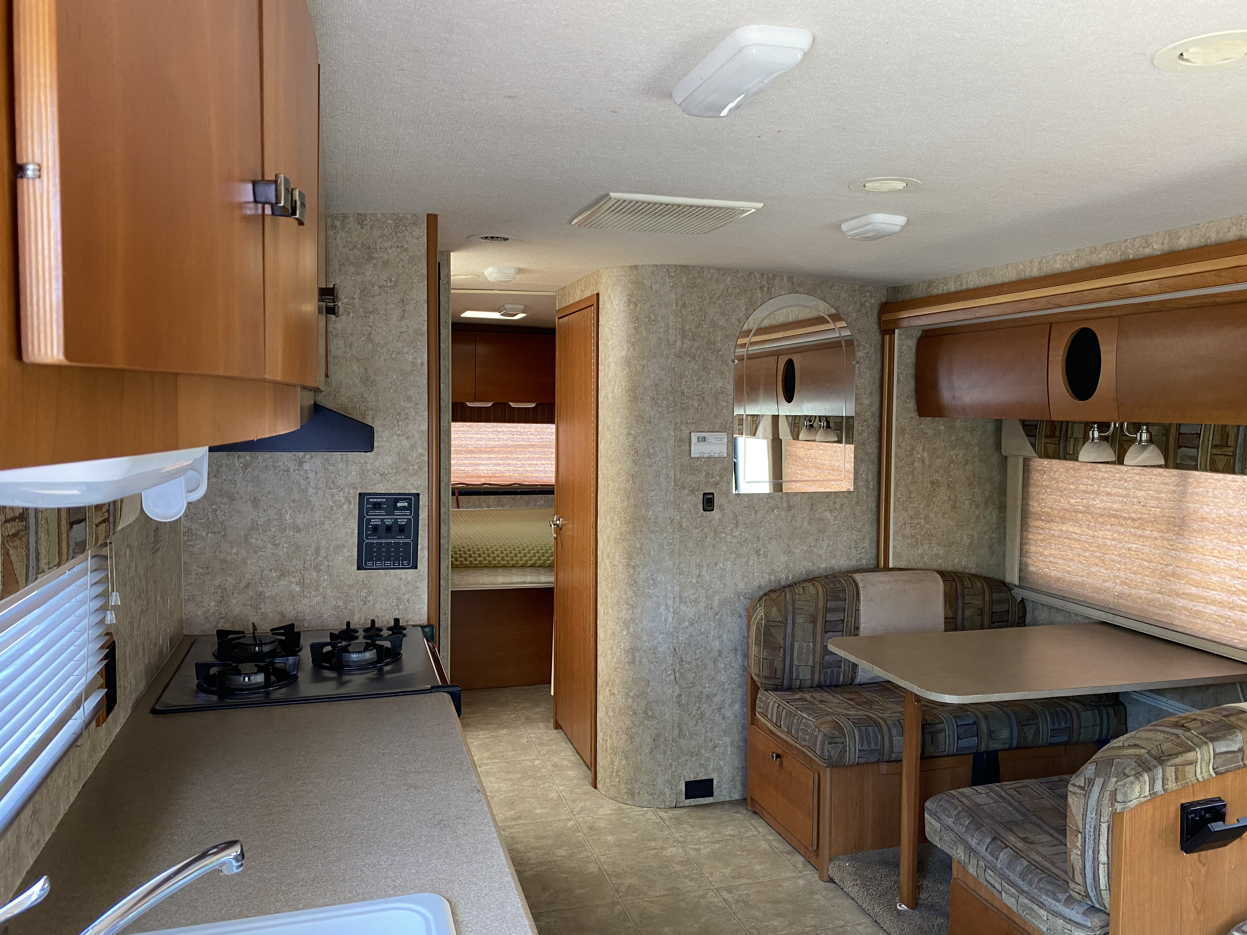Kitchen & Dining Area With Lots Of Cabinet Room- Dinette Folds into Single Bed For One Adult or A Few Children. Winnebago Outlook 2007