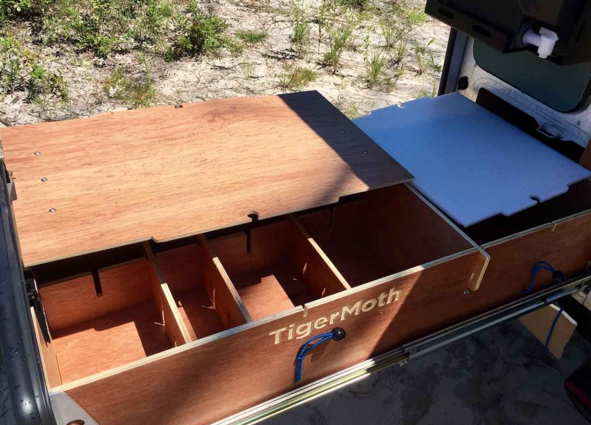 Pull out kitchen set up with cutting board and shelf for stove.. TAXA Outdoors Tigermoth Trek 2017