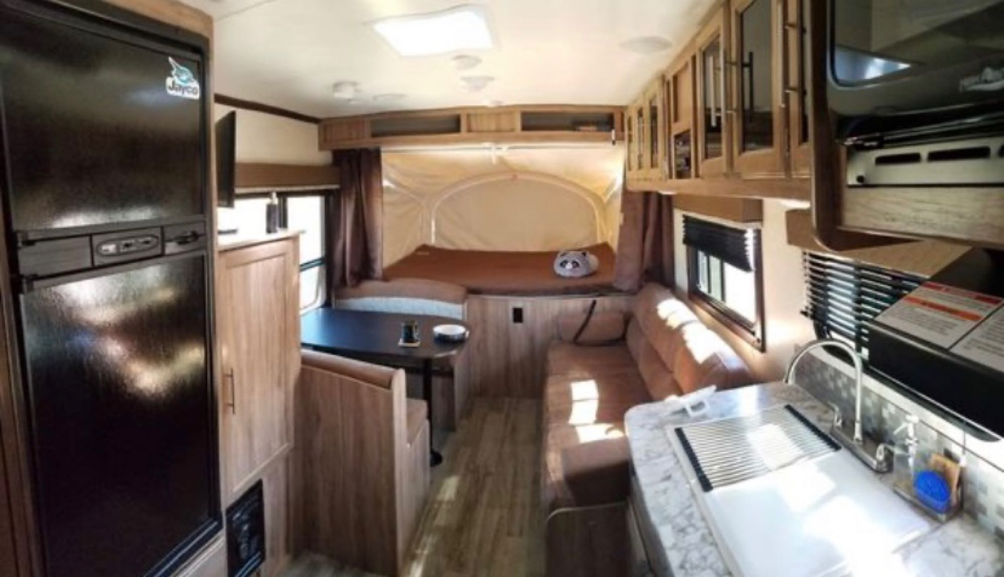 Full kitchen with oven, stove, microwave, refrigerator, and freezer. Jayco Jay Feather 2018