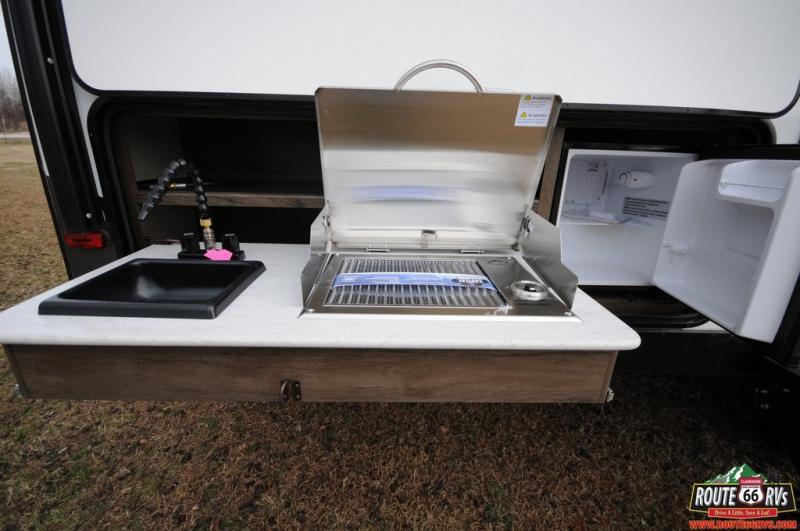 Outdoor wash station, 2 burner stove, 120v party fridge. Prime Time Tracer 2021