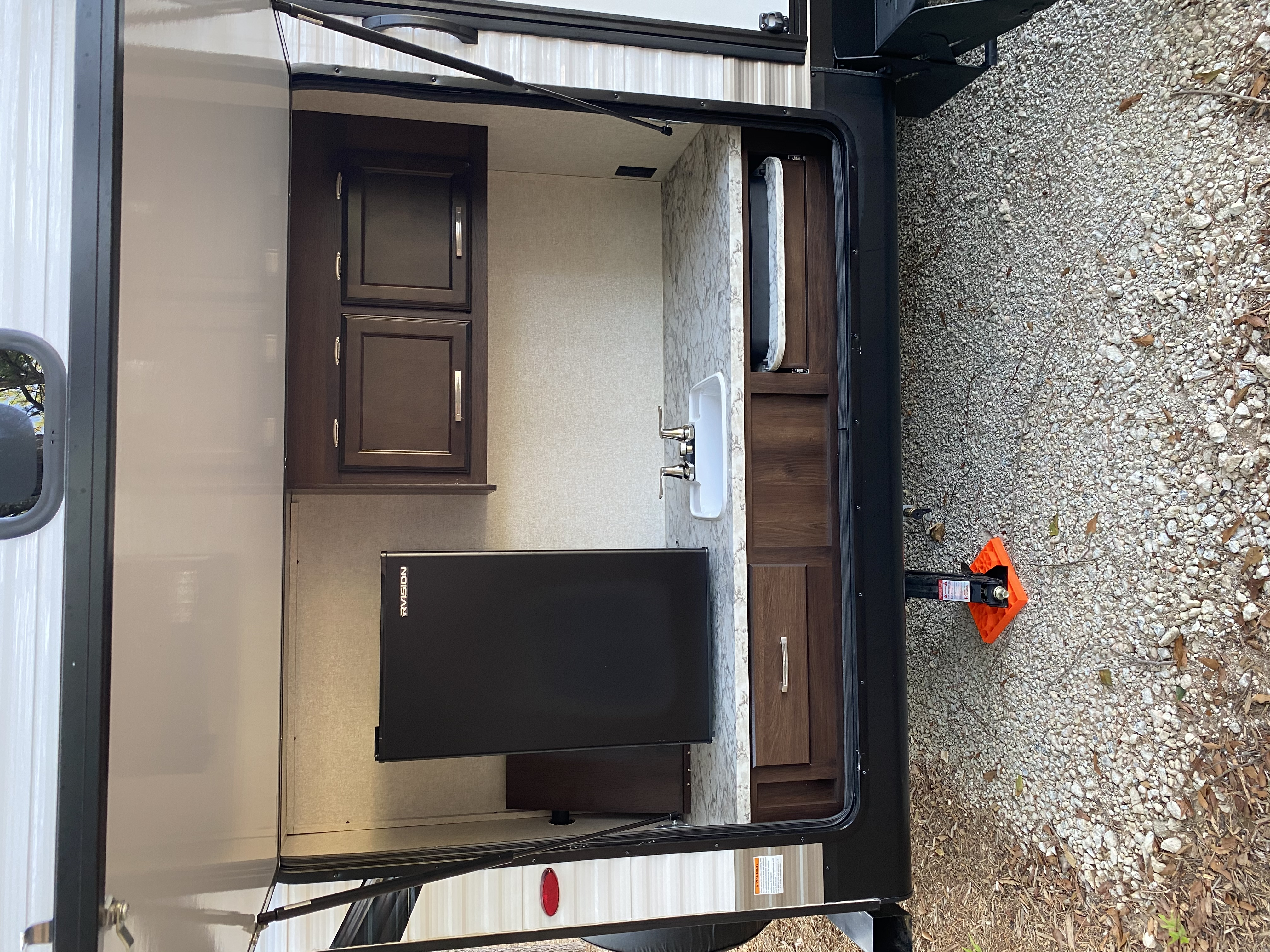 Outdoor Kitchen with fridge, sink, and cooktop. Jayco Jay Flight 2020