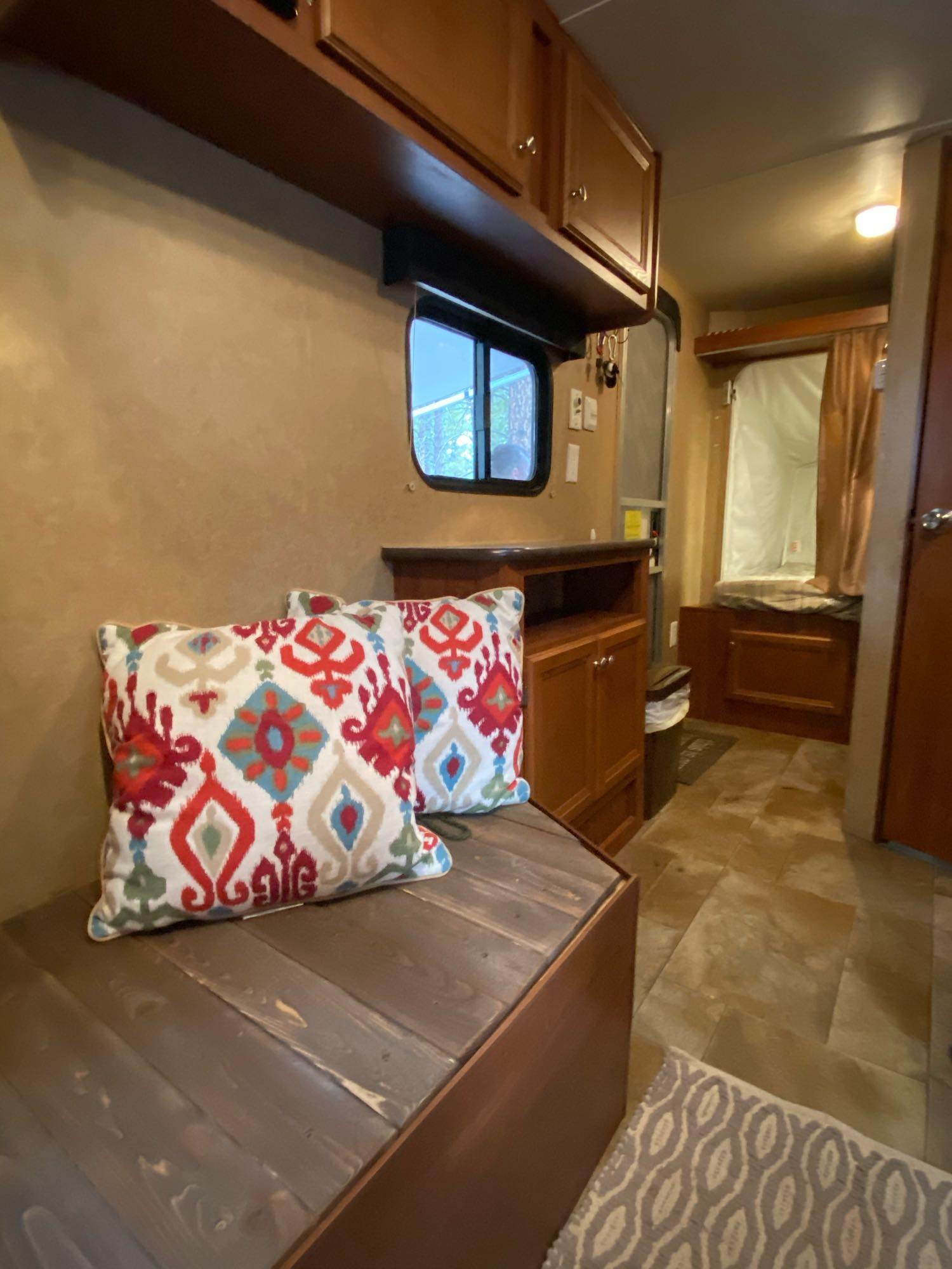 Entry way, storage bench and the pop-out bed. Jayco Jay Flight Swift 2013