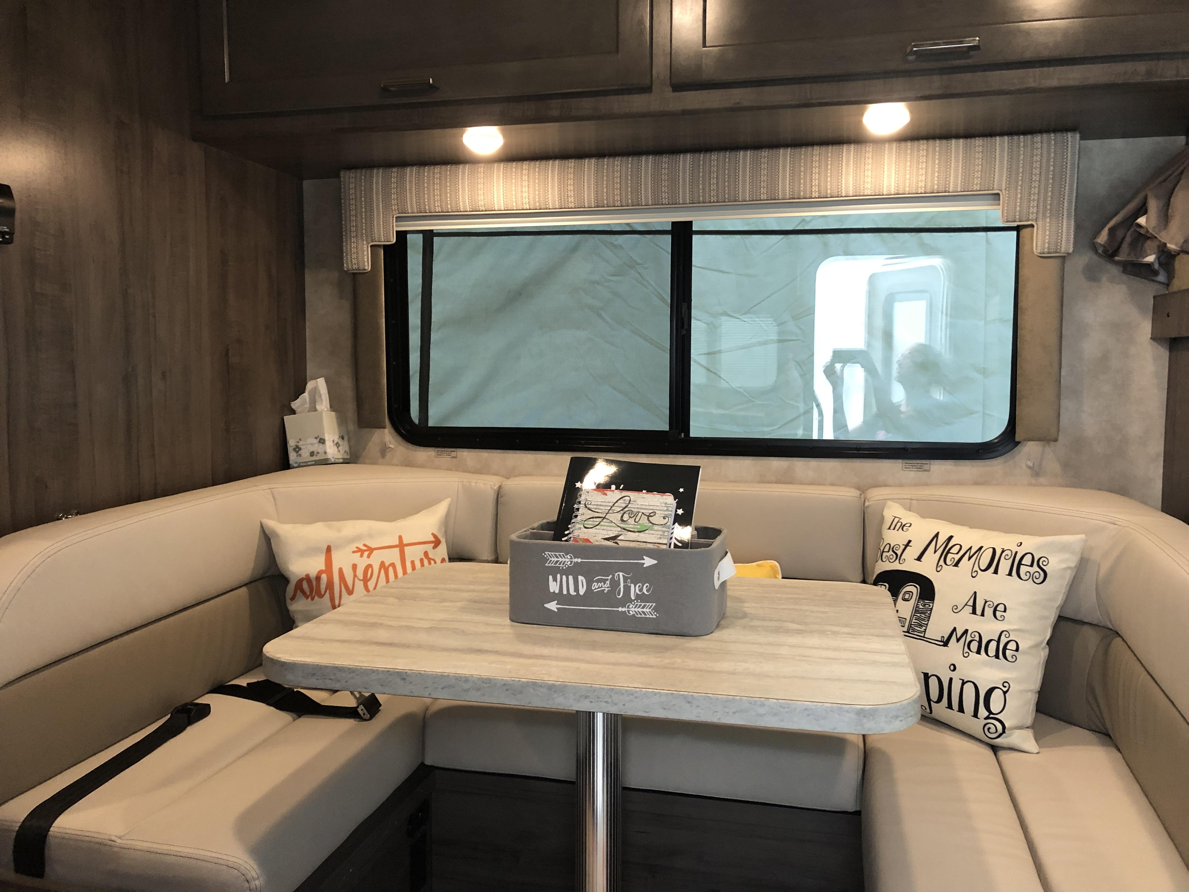 Food storage up above. Seatbelts for added safety when the RV is en route.. Winnebago Minnie Winnie 2018