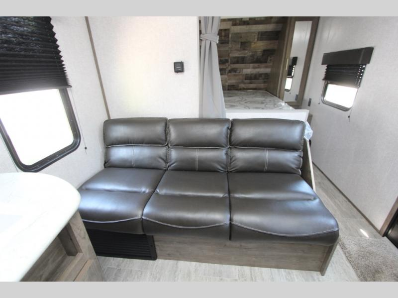 Large sofa with pull down cup holders. Dutchmen Aspen Trail 2021