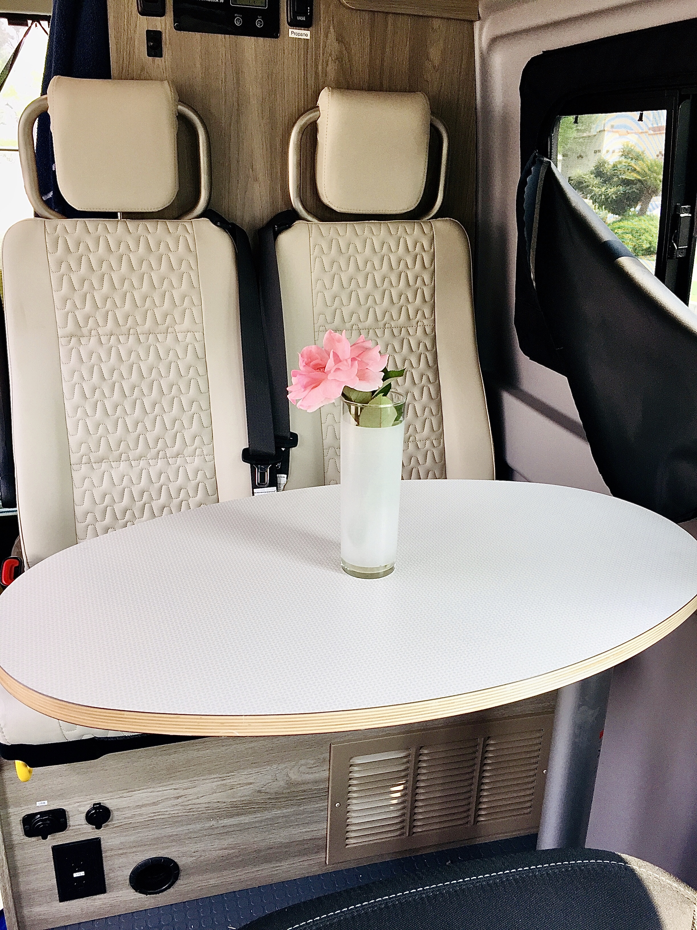 Passenger seats have a table to play cards while the captain is driving.. Winnebago Solis 2021