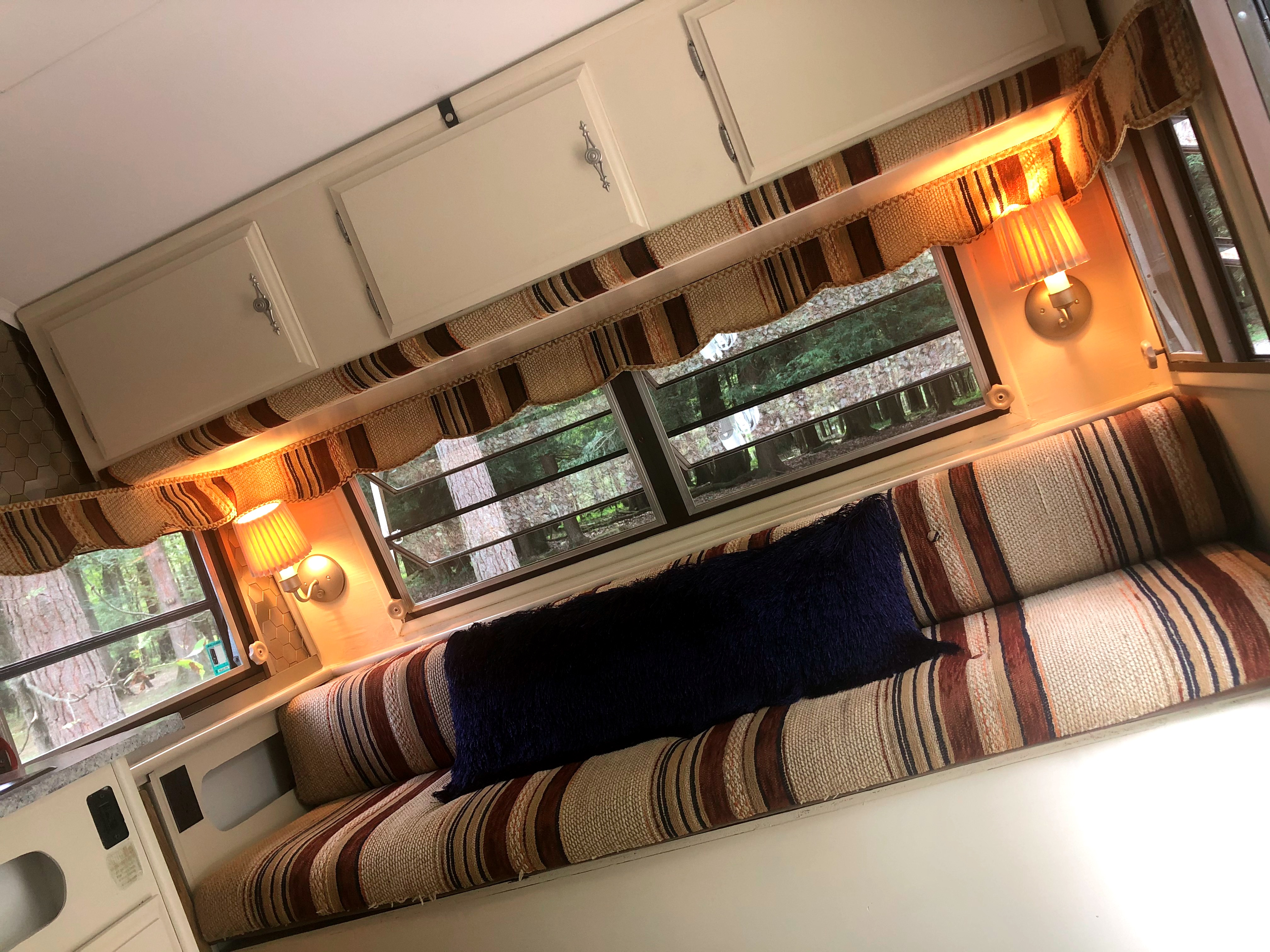 Above: cabinets and/or bunk bed Below: double pull-out bed. Serro Scotty Hilander 1983